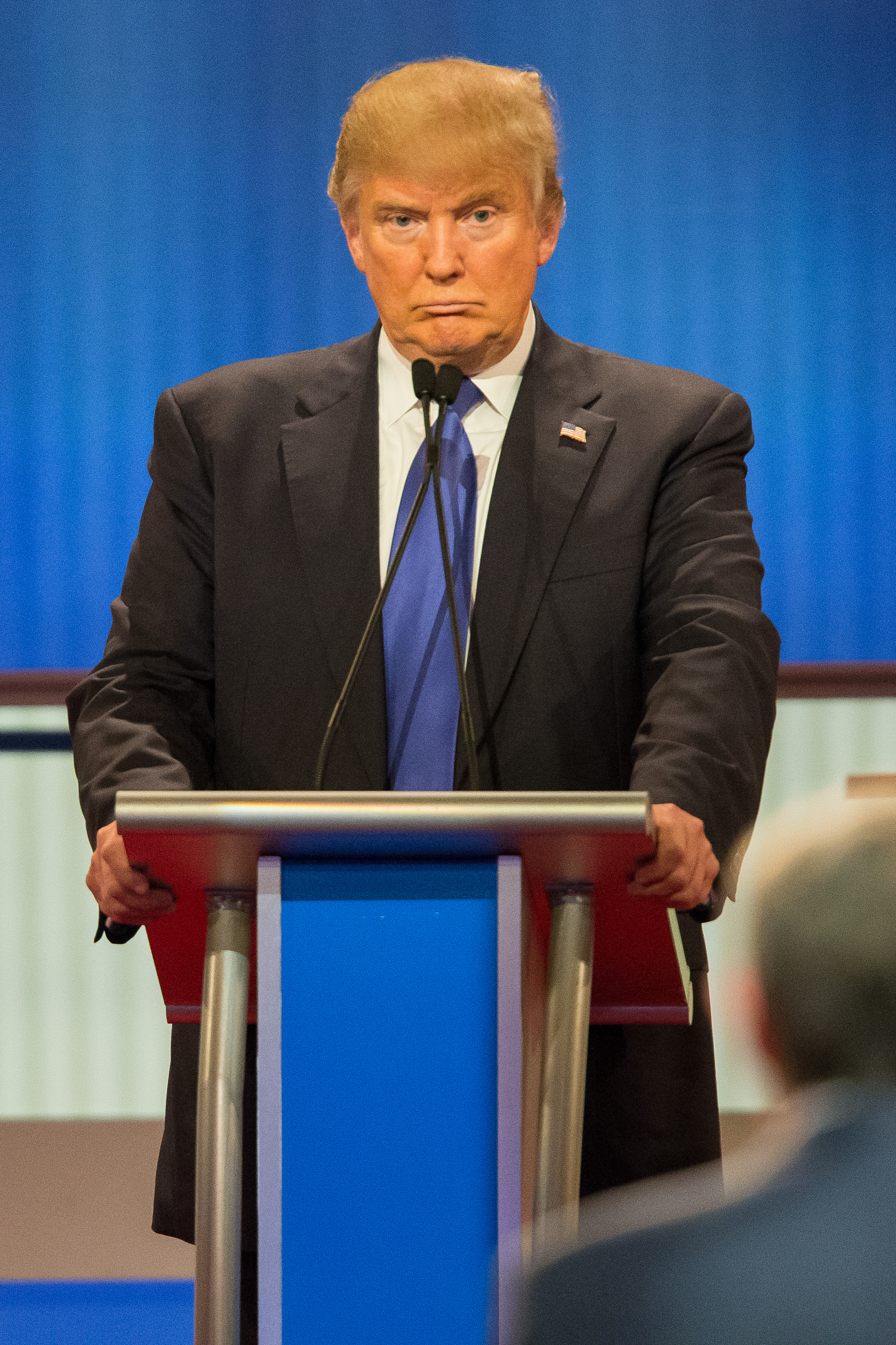 Republican Presidential candidate Donald Trump reacts to a question during the Republican Presidential Debate in Detroit, Michigan, March 3, 2016.