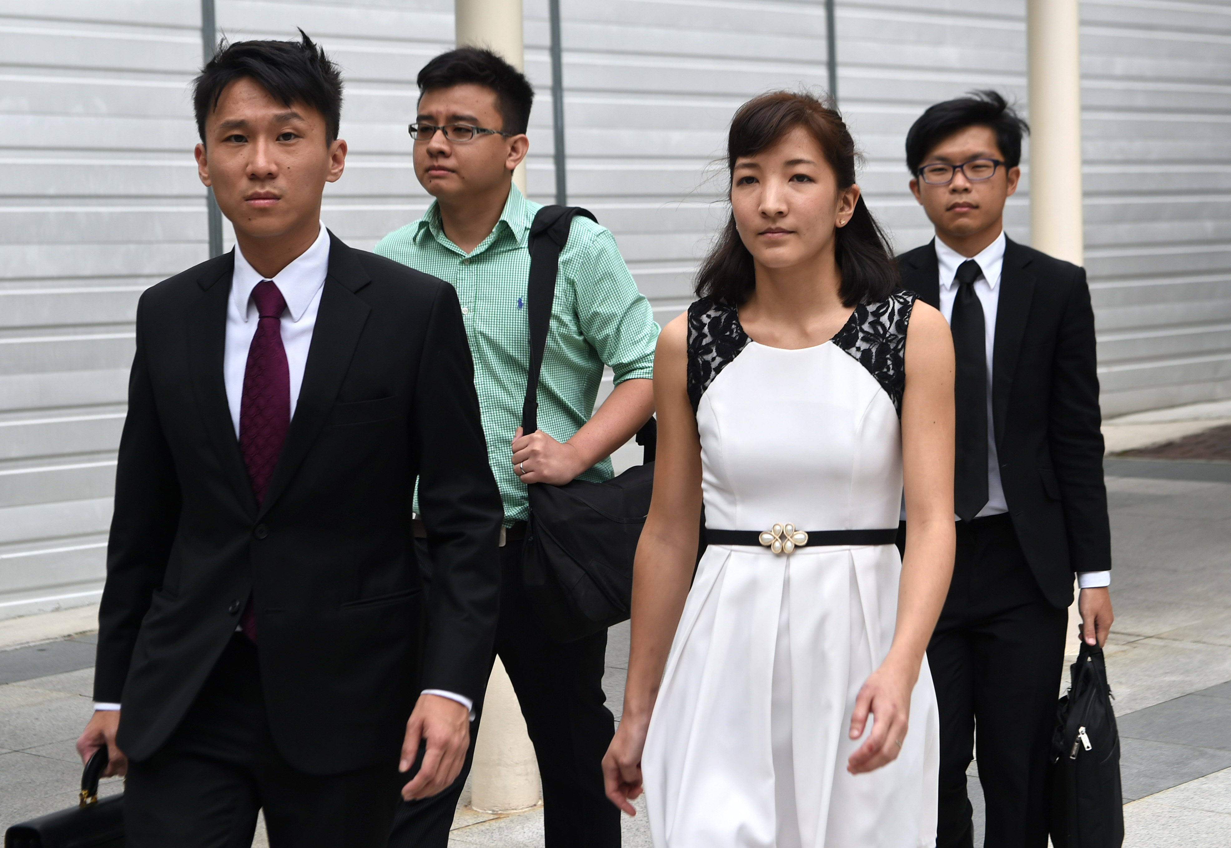 Australian Japanese Ai Takagi, front right, and her Singaporean husband Yang Kaiheng, back left, with their lawyer Choo Zheng Xi, front left, leave the state court after a trial in Singapore on March 7, 2016