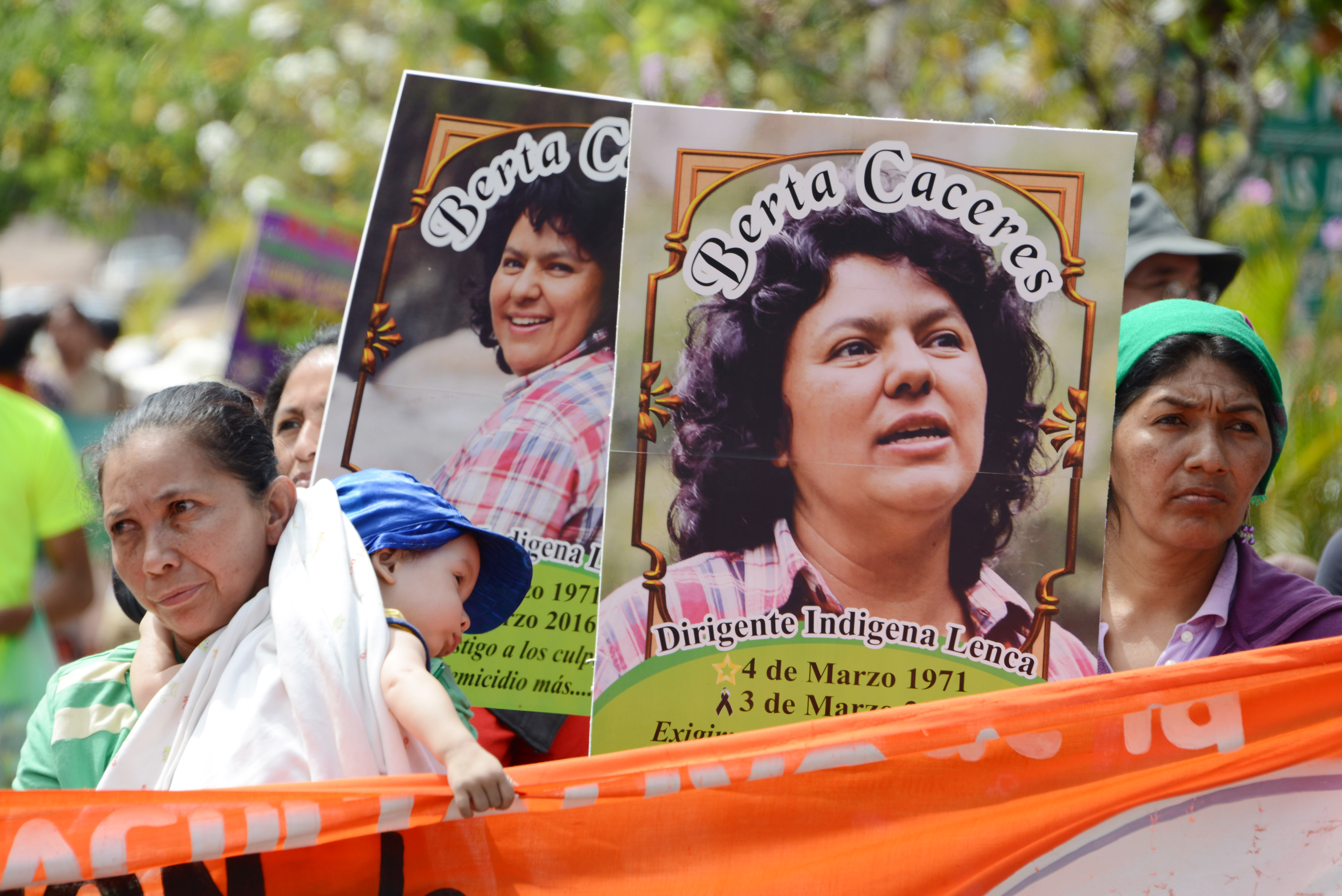 Slain Honduran environmentalist Berta Caceres posters are carried  during a International Women's day demonstration in Tegucigalpa on March 08, 2016