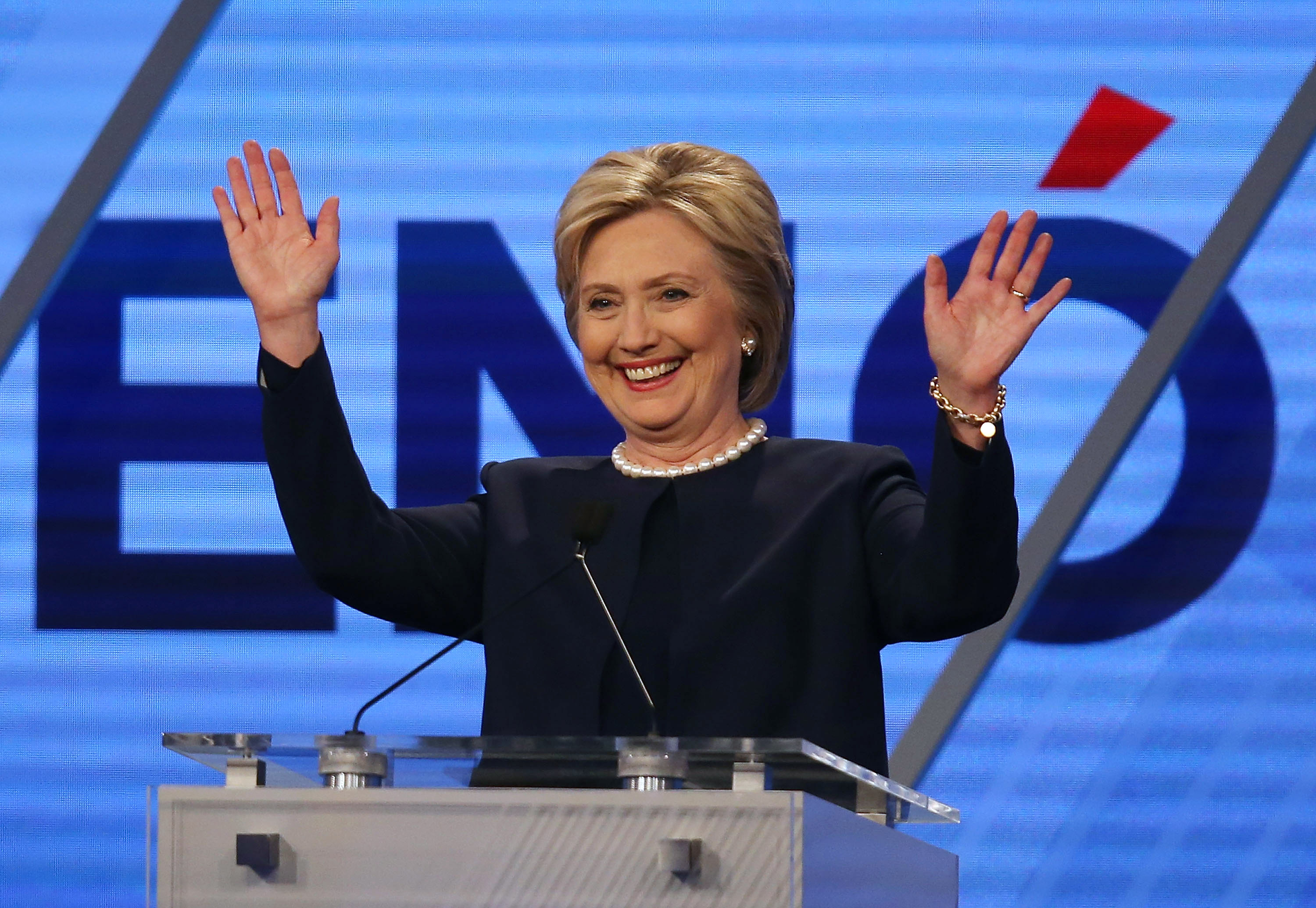 Democratic presidential candidate Hillary Clinton waves during her debate against Sen. Bernie Sanders (D-VT) at the Univision News and Washington Post Democratic Presidential Primary Debate on March 9, in Miami, Florida.