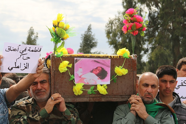 Iraqis carry the coffin of a young girl reportedly killed by ISIS chemical weapons in Kirkuk on Saturday.