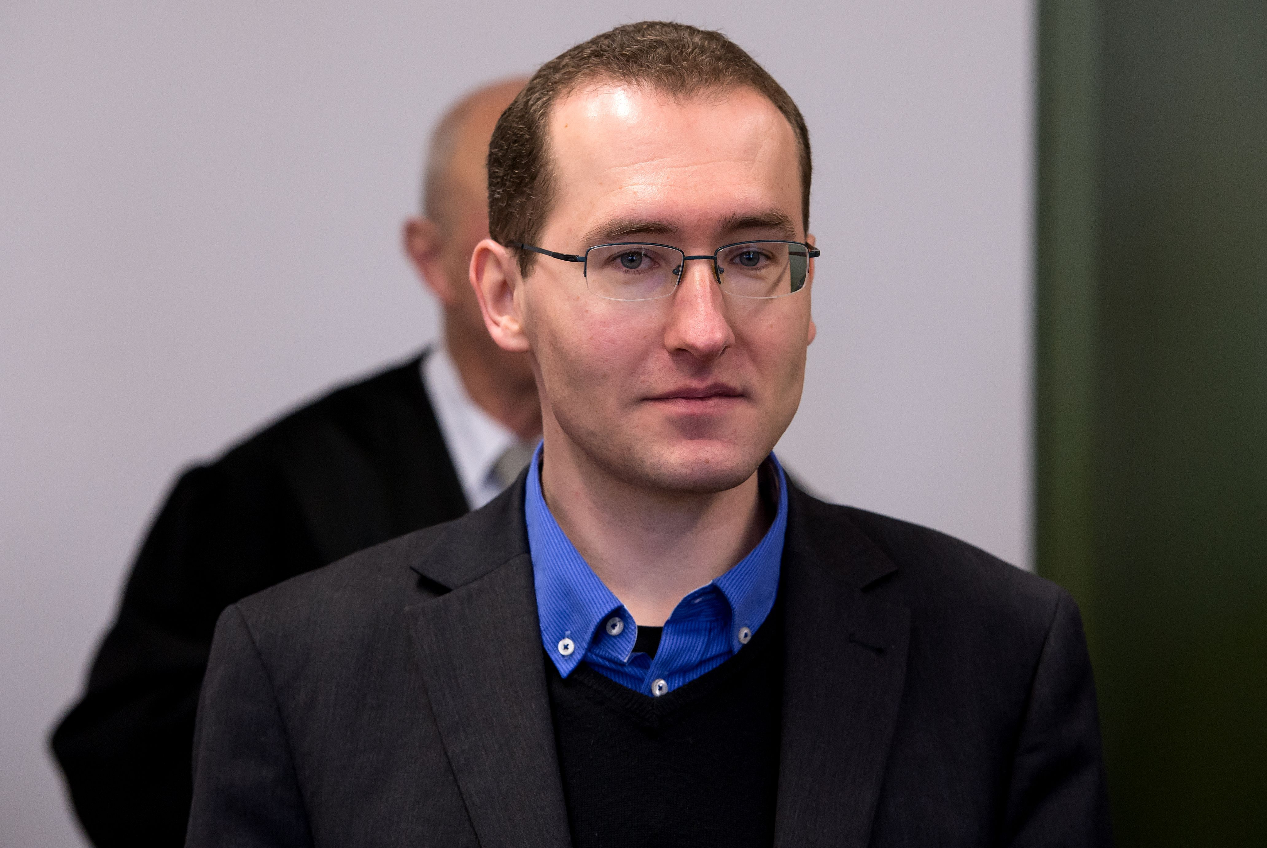 Markus Reichel, a former employee of Germany's Federal Intelligence Service, arrives for his trial at the higher regional court in Munich on March 17, 2016