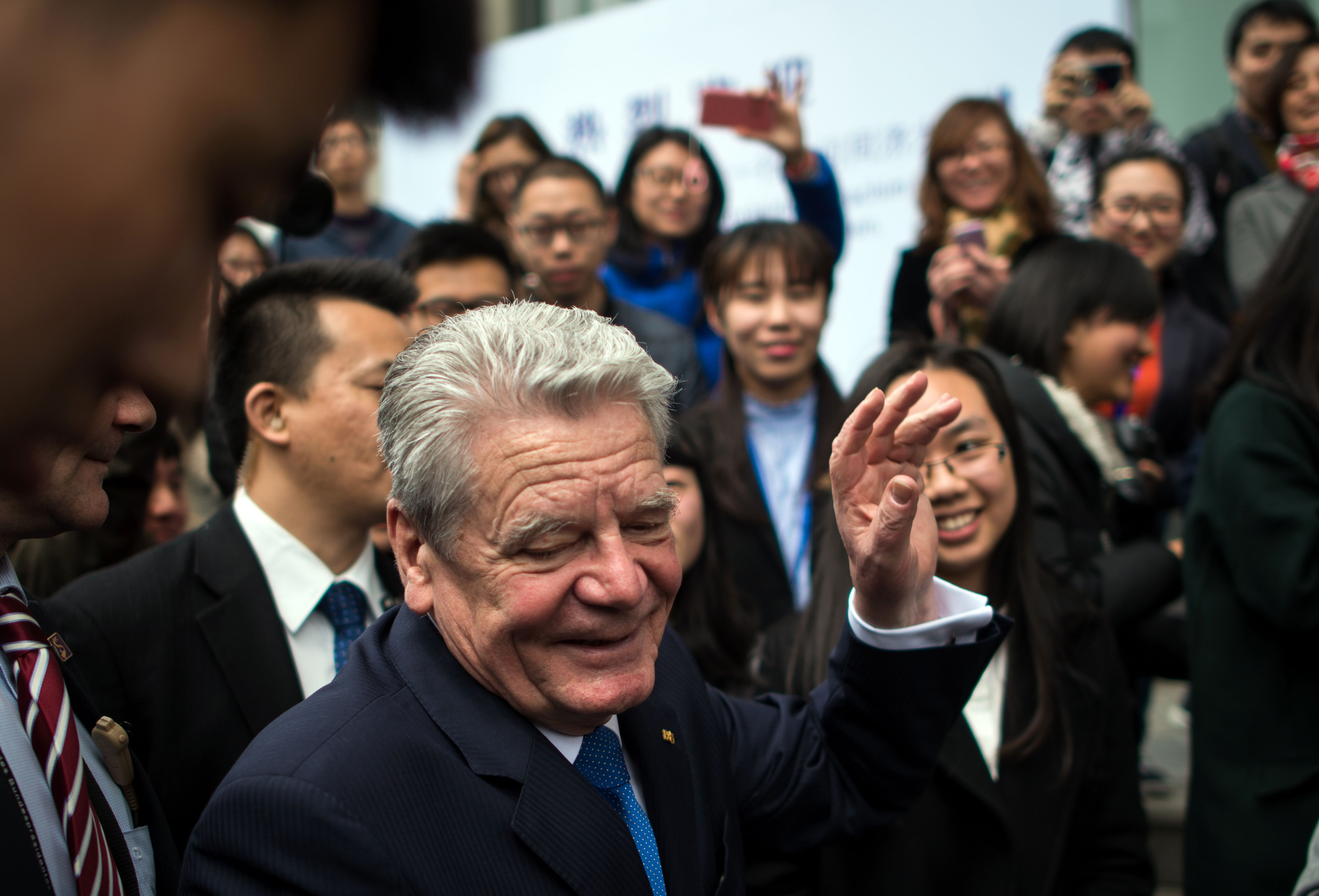 German President Joachim Gauck talks with students after his speech at Tongji University in Shanghai on  March 23, 2016