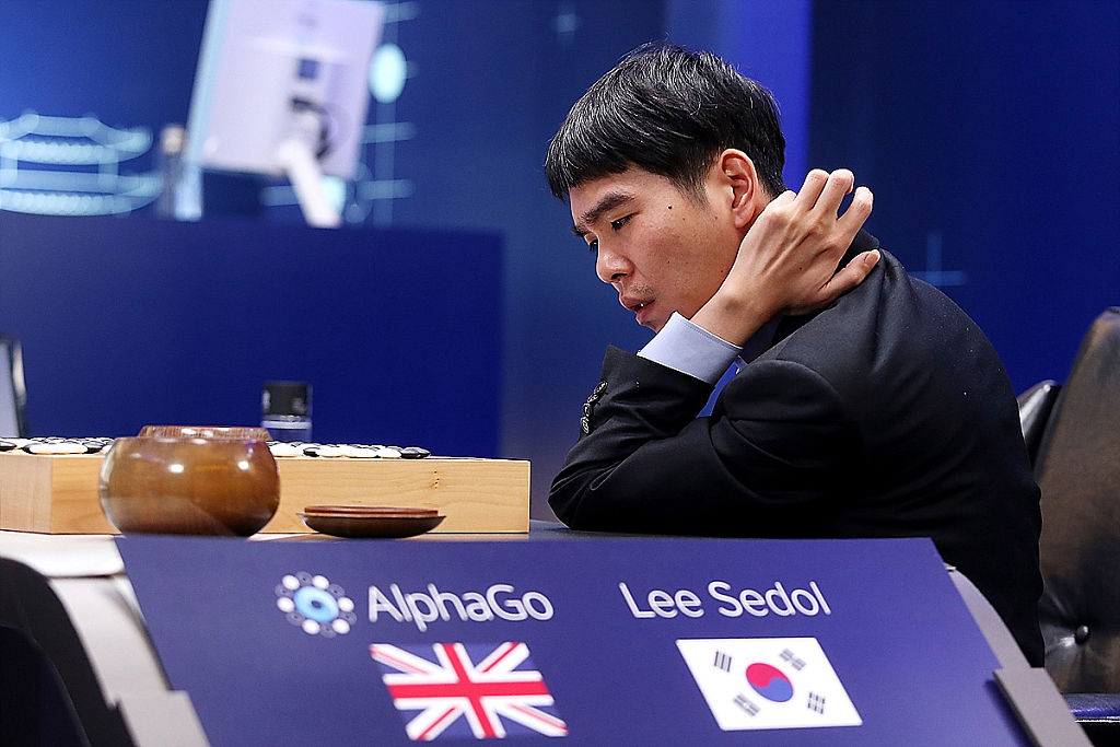 South Korean professional Go player Lee Sedol reviews the match after the fourth match against Google's artificial intelligence program, AlphaGo, during the Google DeepMind Challenge Match on March 13, 2016 in Seoul, South Korea.