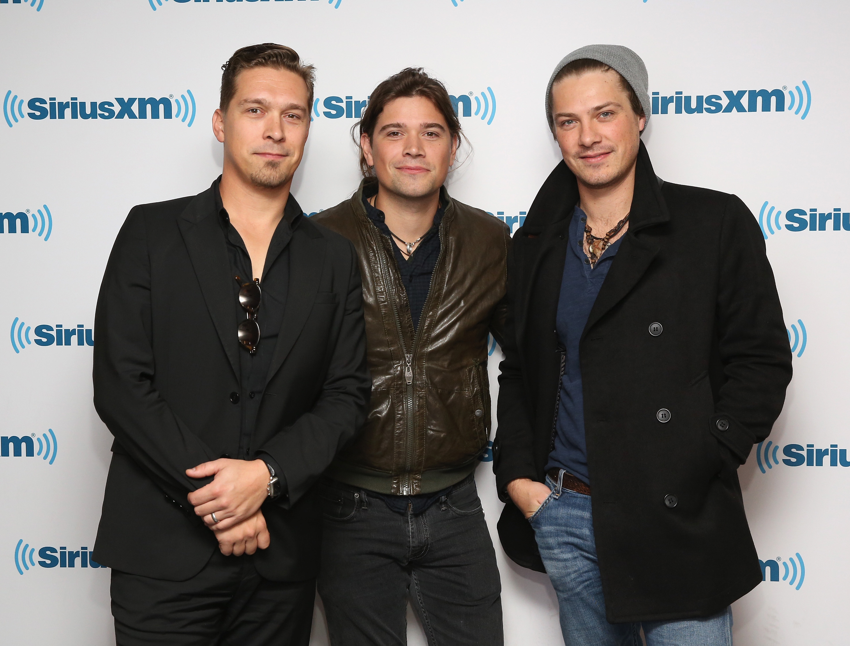 Isaac Hanson, Zac Hanson and Taylor Hanson of Hanson visit at SiriusXM Studios on October 16, 2015 in New York City.