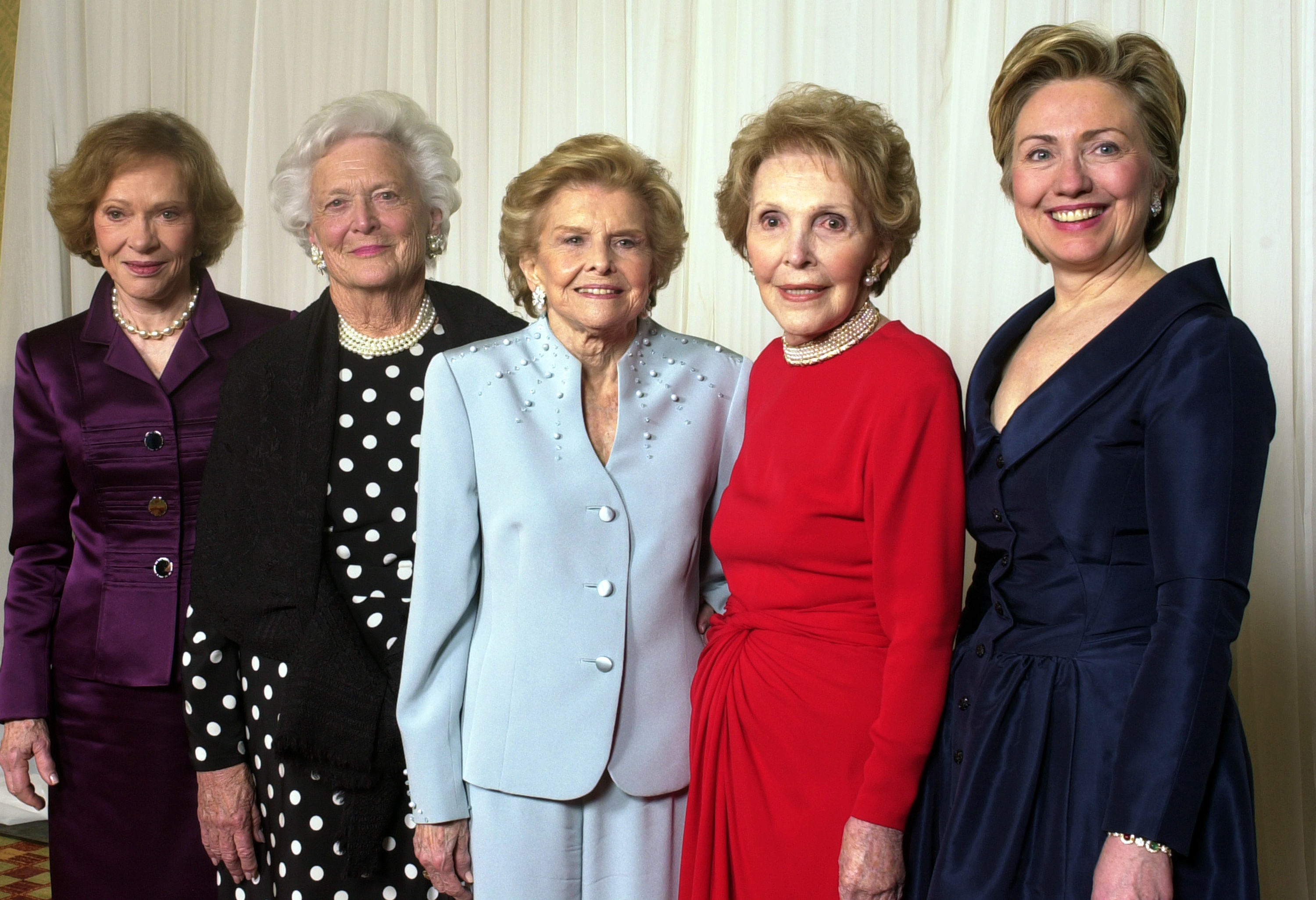 Former first ladies get together for a group photo at a gala 20th anniversary fundraising event saluting Betty Ford and the Betty Ford Center in Indian Wells, Calif. on Jan. 17, 2003.  From left are Rosalynn Carter, Barbara Bush, Betty Ford, Nancy Reagan and Sen. Hillary Rodham Clinton.