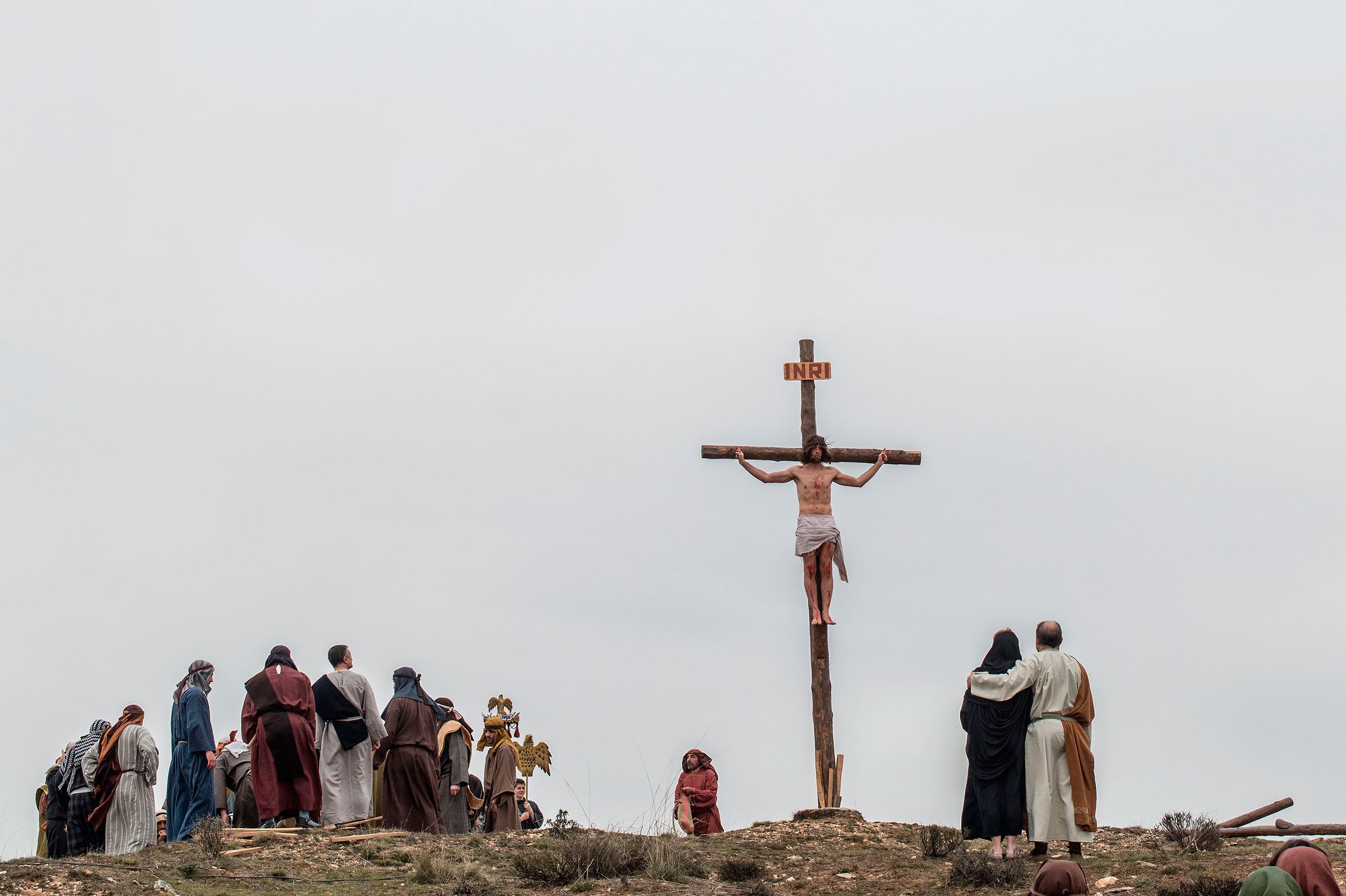 An actor portraying Jesus is crucified as residents dressed in period clothing perform during the reenactment of Christ's suffering, Hiendelaencia, Spain, March 25, 2016.