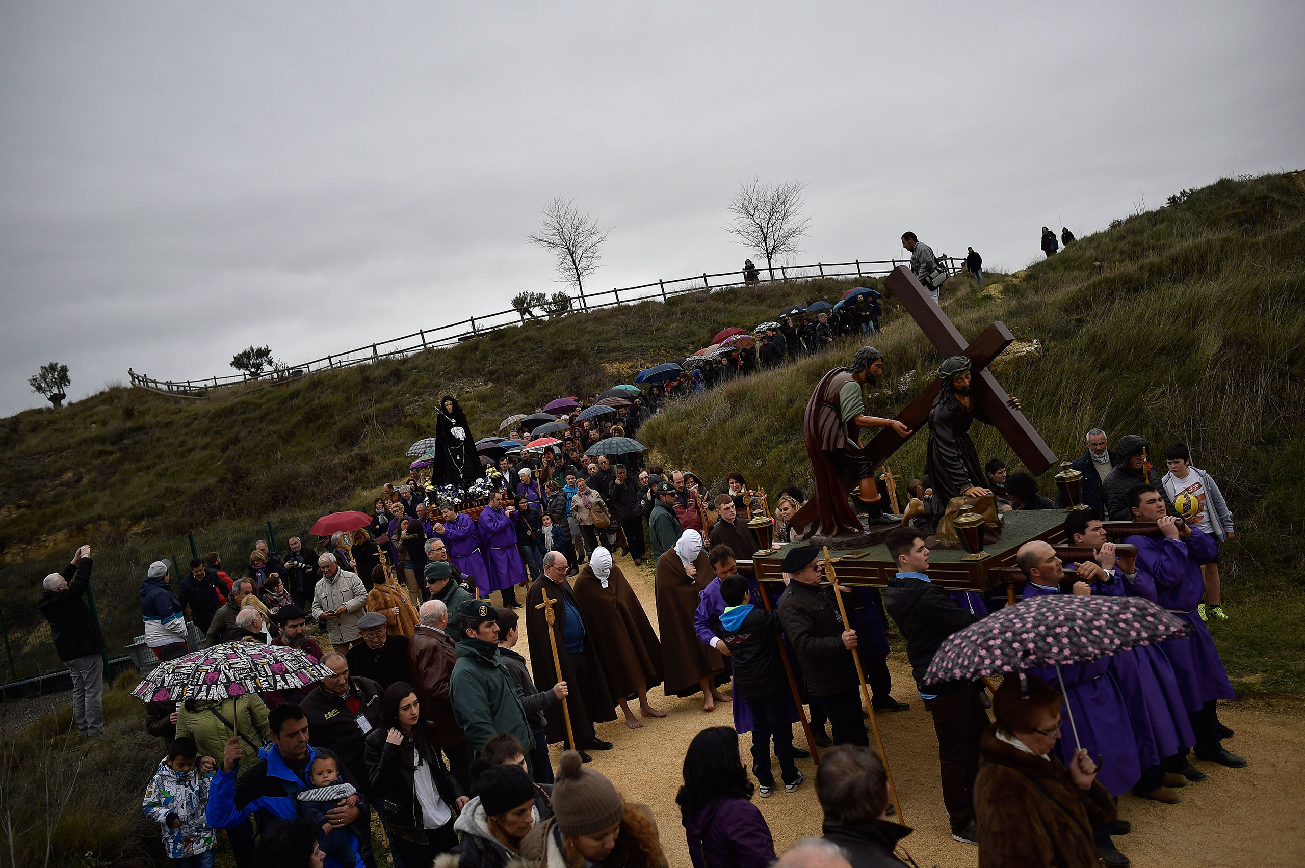Masked penitents from the La Santa Vera Cruz brotherhood take part in an Easter procession known as 'Los Picaos' in the small village of San Vicente de La Sonsierra, northern Spain, March 25, 2016.