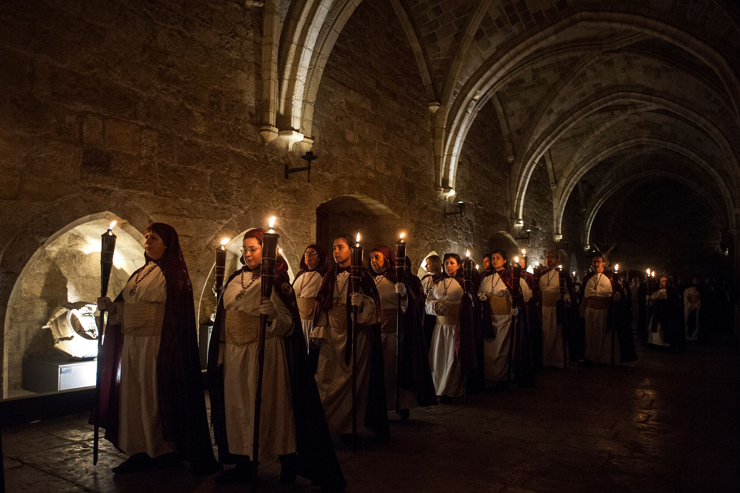 Participants in the procession of the Holy Christ of Peace celebrate on the night of Holy Thursday in Santander, Spain, March 24, 2016.