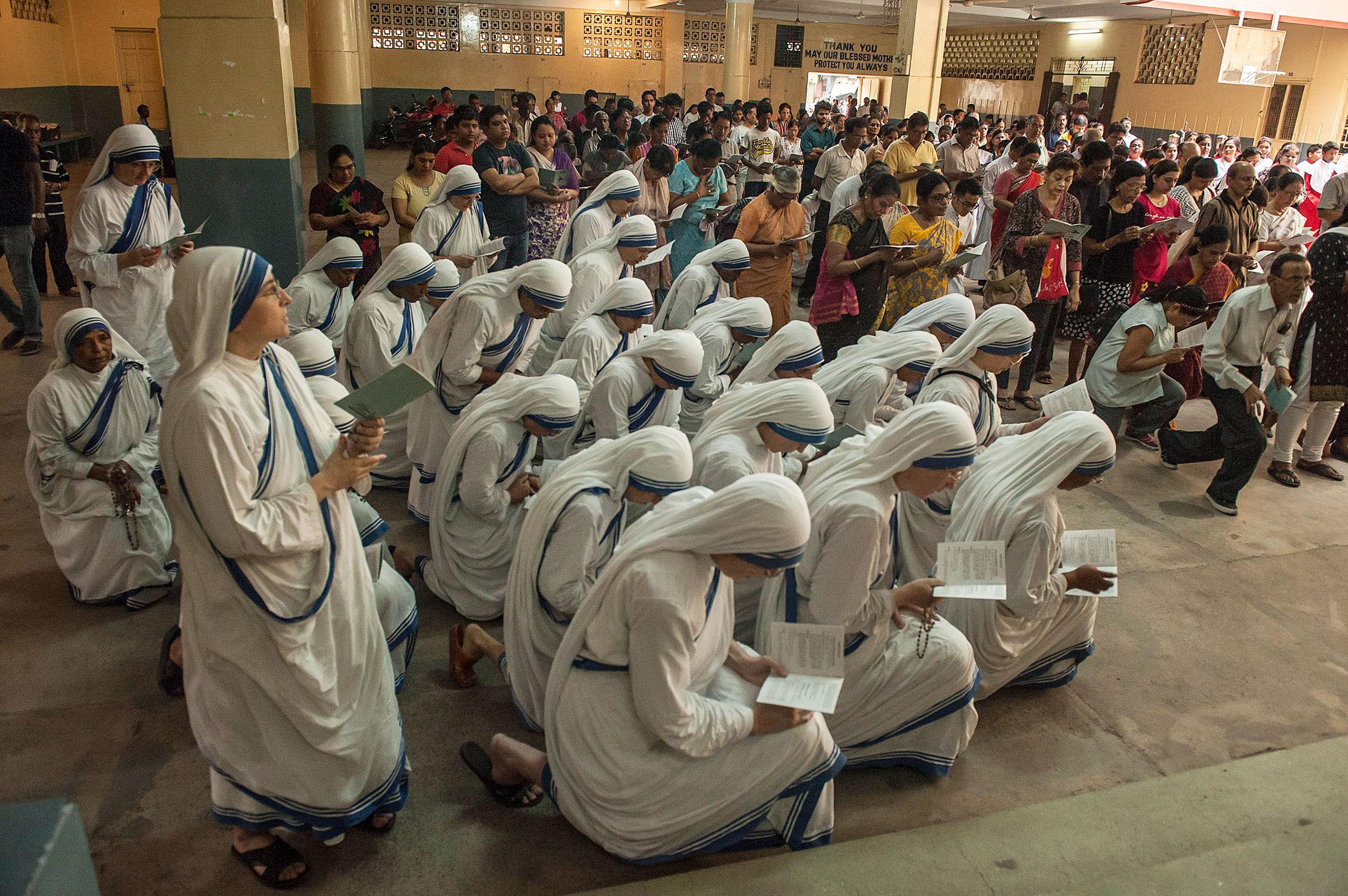 Indian Christians pray at a church on Good Friday in Kolkata, India, March 25, 2016.
