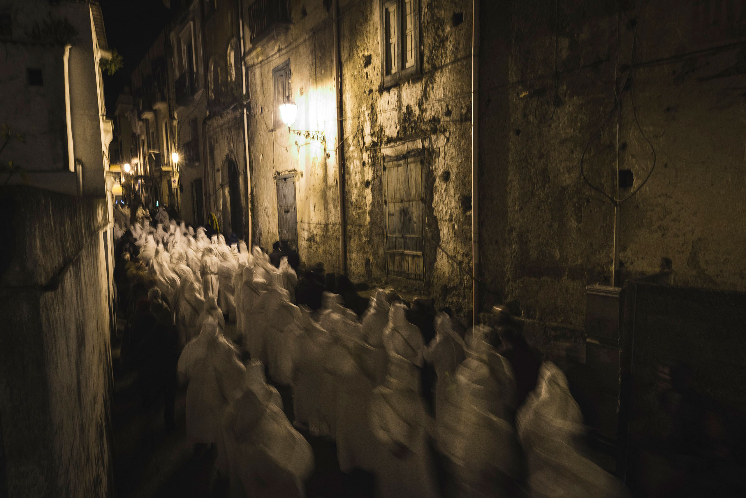 Participants attend the Penitential Procession of the  Battenti  with dozens of hooded penitents and centuries-old songs in Minori, Italy, March 24, 2016.
