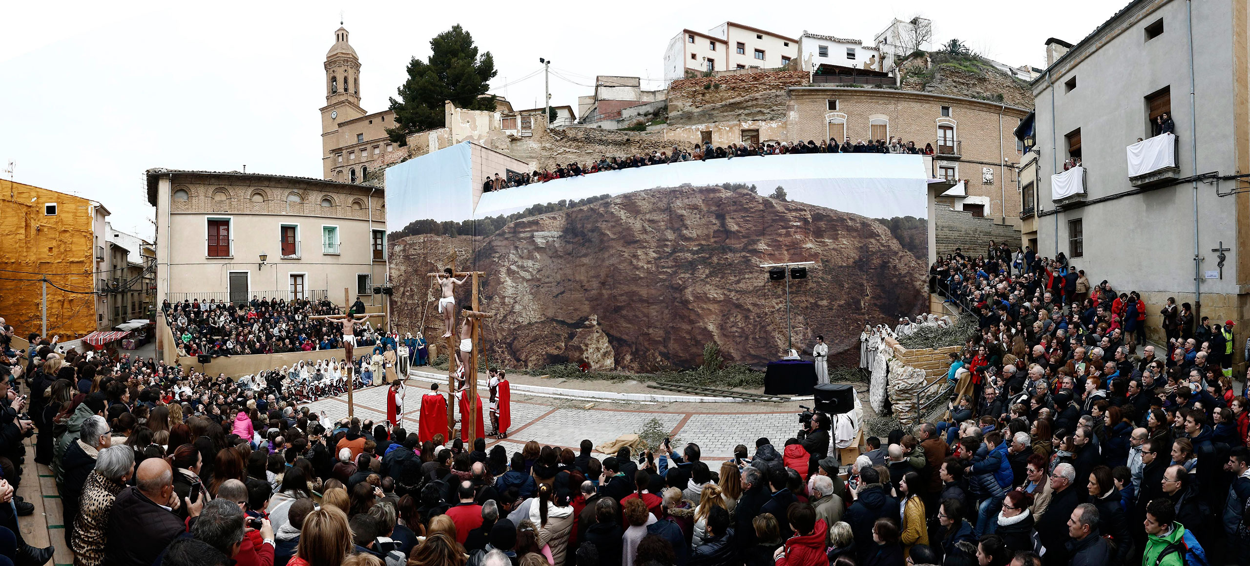 Penitents take part in the reenactment of the viacrucis at Andosilla in Navarra, Spain, March 25, 2016.