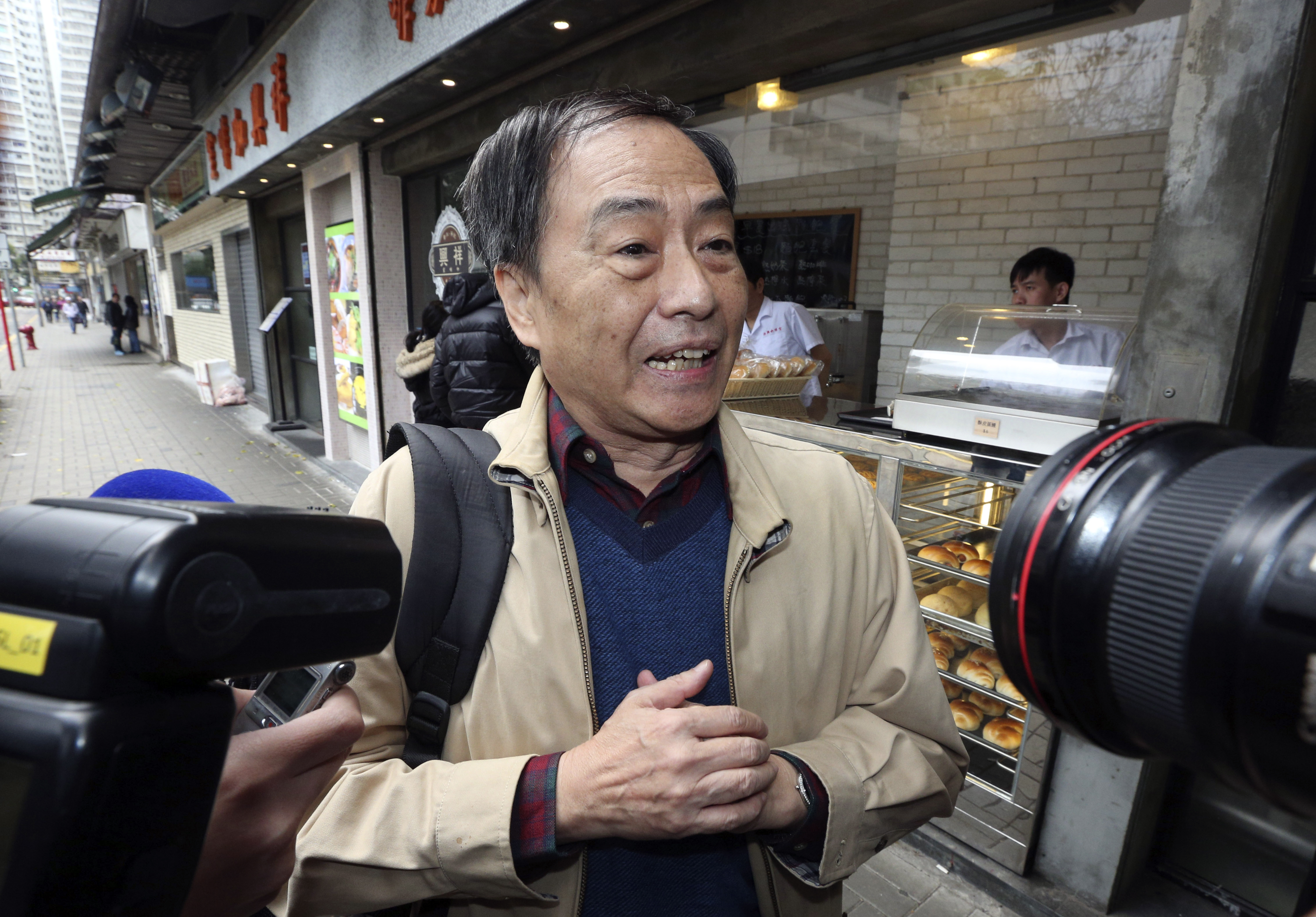 Bookseller Lee Bo speaks to media near his home in Hong Kong on March 25, 2016. His disappearance nearly three months ago rattled civil-liberties advocates in Hong Kong