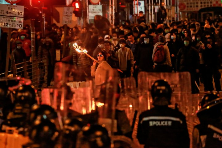 In a rare violent night, protesters confront police Feb. 9 in the Hong Kong district of Mong Kok