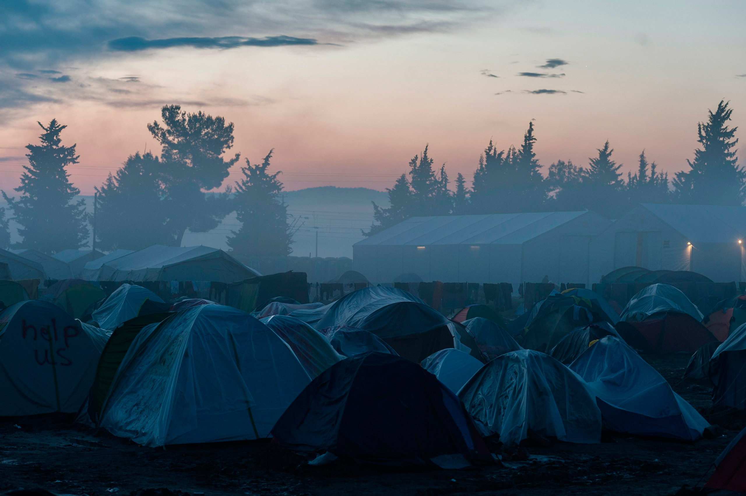 Fog engulfs a makeshift camp for migrants and refugees at the Greek-Macedonian border, near the Greek village of Idomeni, March 11, 2016. Markus Heine—NurPhoto/Corbis