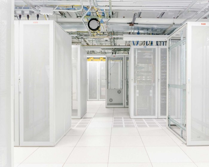 """Servers racks inside a peering exchange at 85 10th ave, where large networks exchange traffic with others when a mutual benefit exists. These facilities are """"carrier neutral"""" so that any carrier can exchange traffic with another- a policy which and makes peering efficient."""
