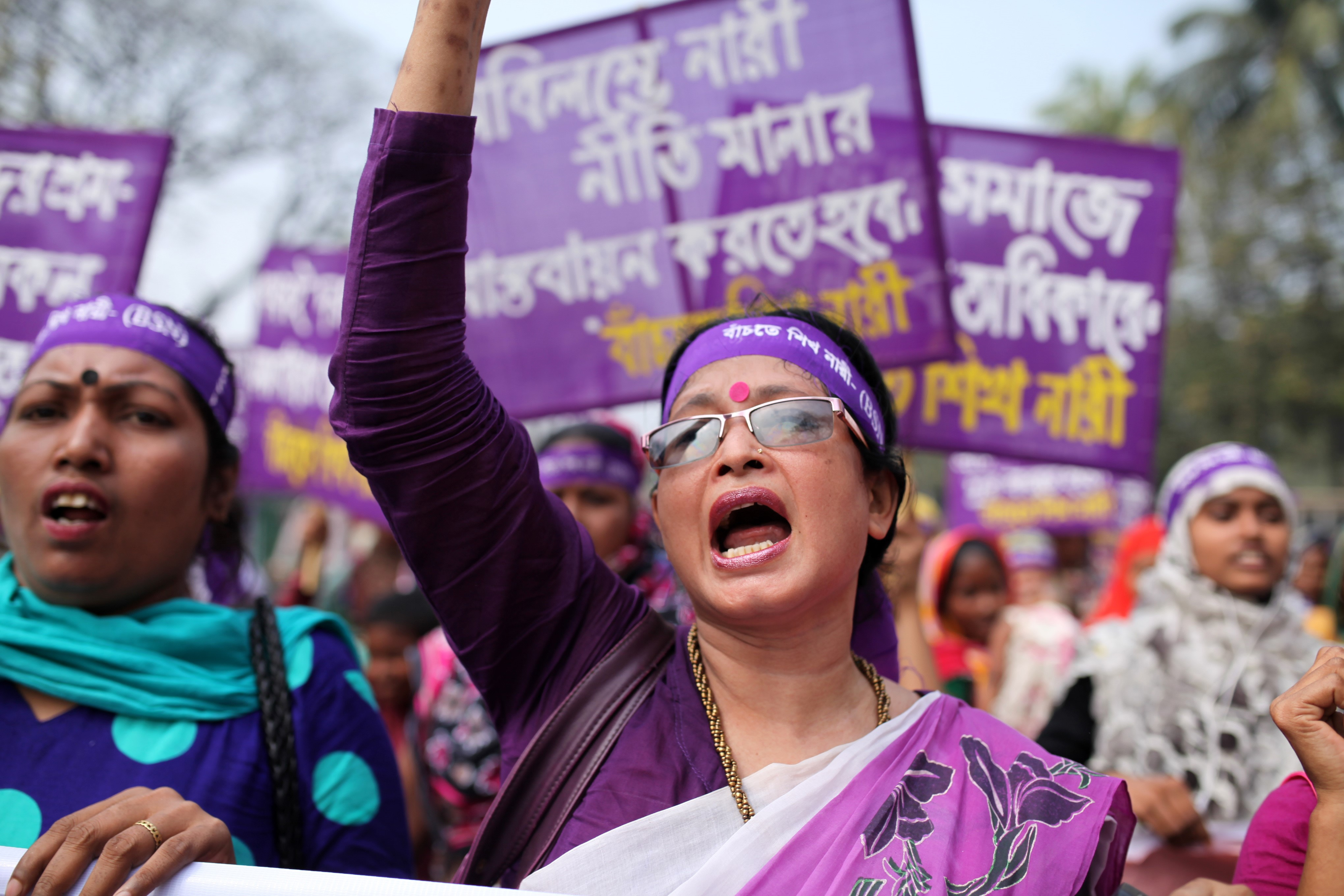 Bangladeshi activists and garment workers attend a rally in front of National Press Club during International Women's Day in Dhaka, Bangladesh on March 08, 2016.