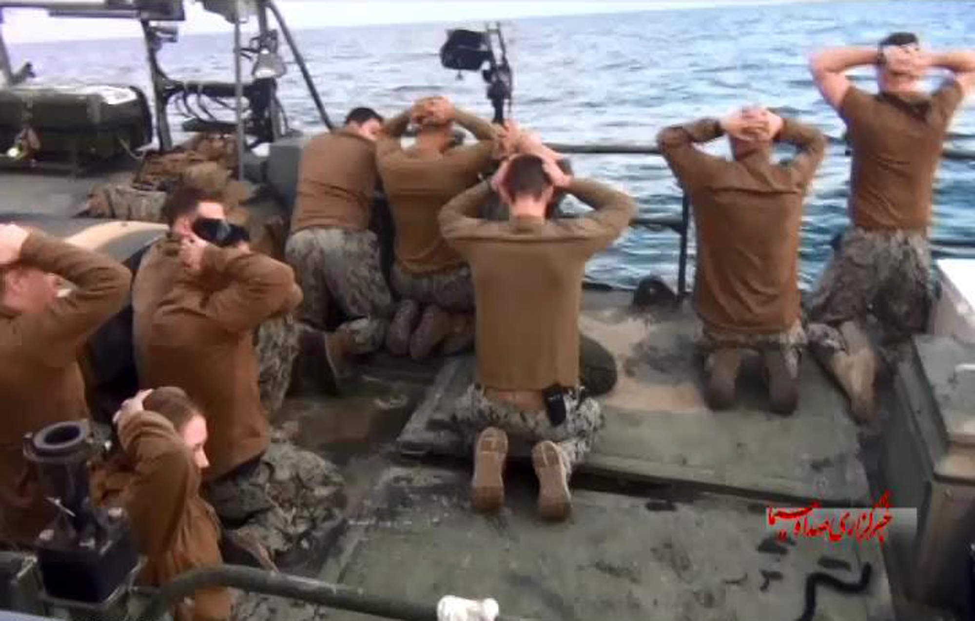 This picture released by the Iranian state-run IRIB News Agency on Jan. 13, 2016, shows detention of American Navy sailors by the Iranian Revolutionary Guards in the Persian Gulf, Iran.