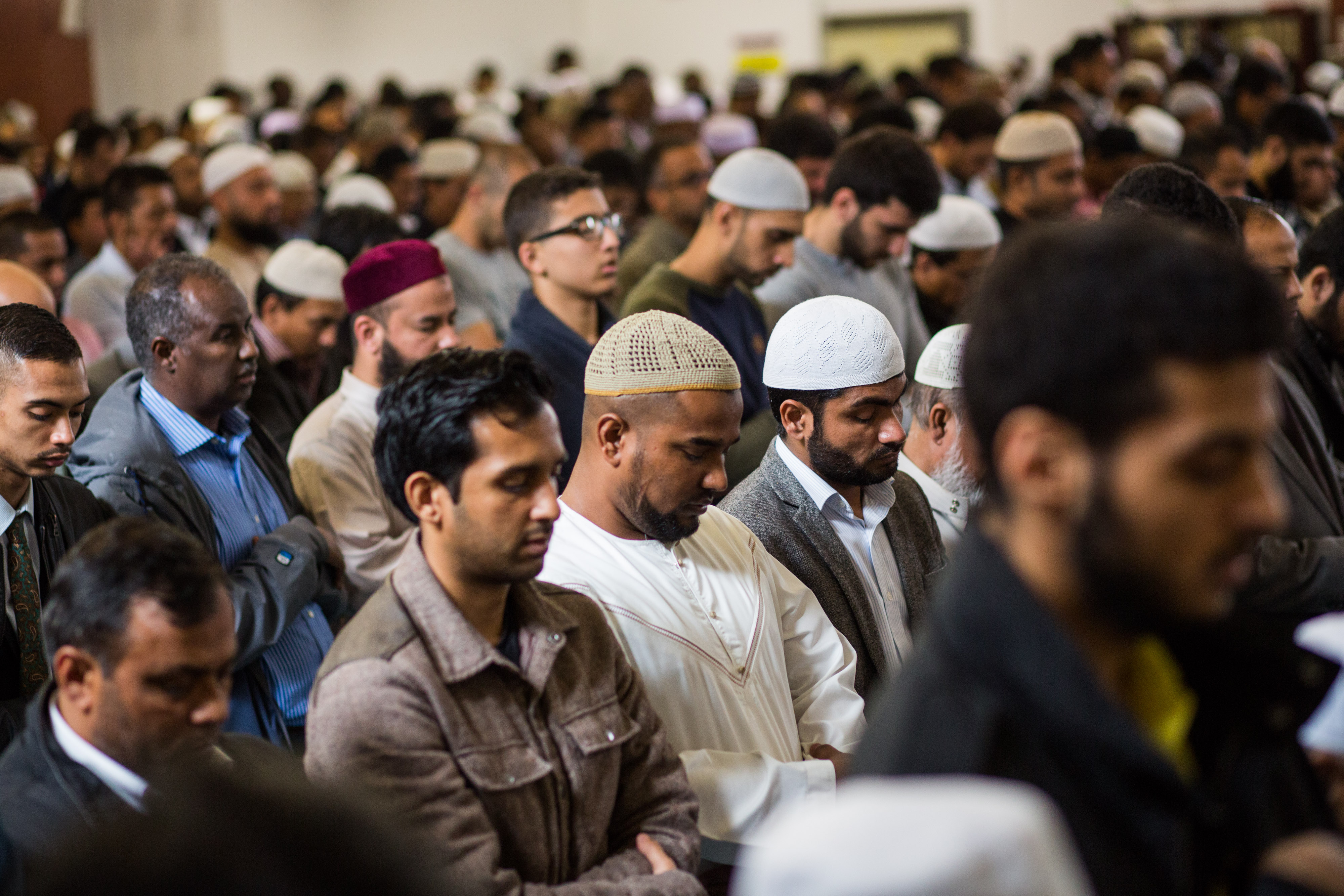 Men attend the first Friday prayers of the Islamic holy month of Ramadan at the East London Mosque on June 19, 2015 in London, England.