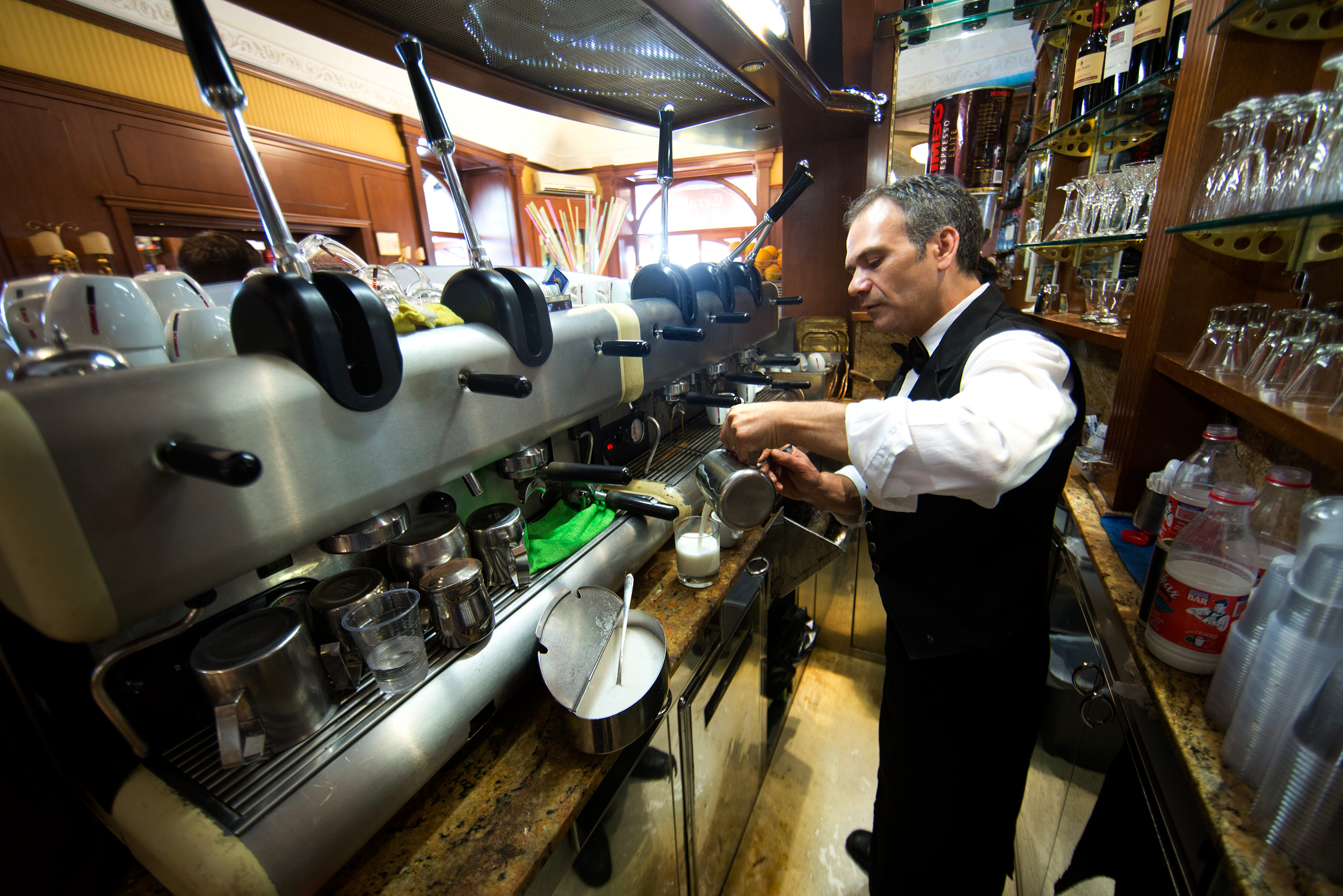 A senior coffee maker at Garaldi Caffe, located at Piazza Garita in Naples, Italy, Oct. 1, 2014.