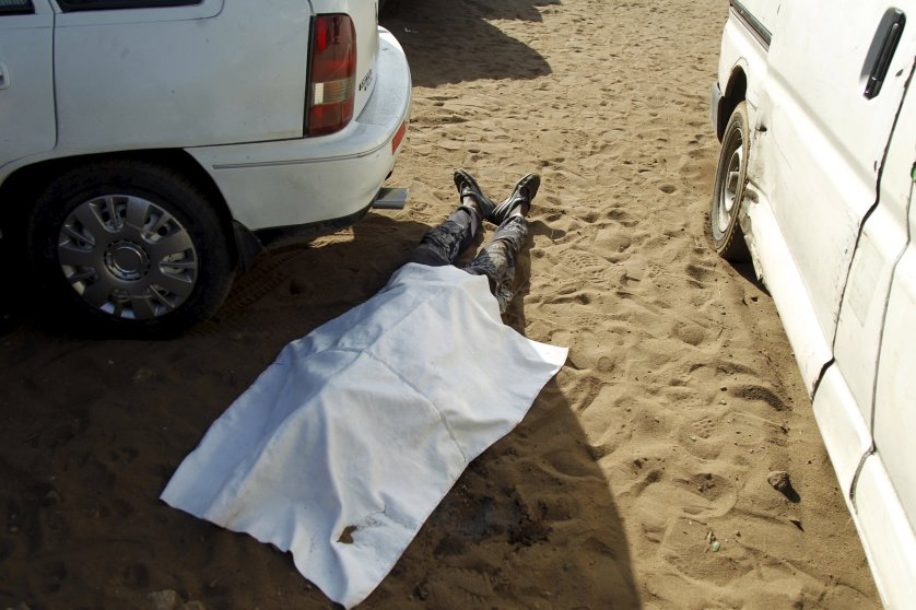 ATTENTION EDITORS - VISUALS COVERAGE OF SCENES OF DEATH OR INJURY A body is seen covered with tarp on the beach in Bassam, Ivory Coast, March 13, 2016. REUTERS/Luc Gnago TEMPLATE OUT