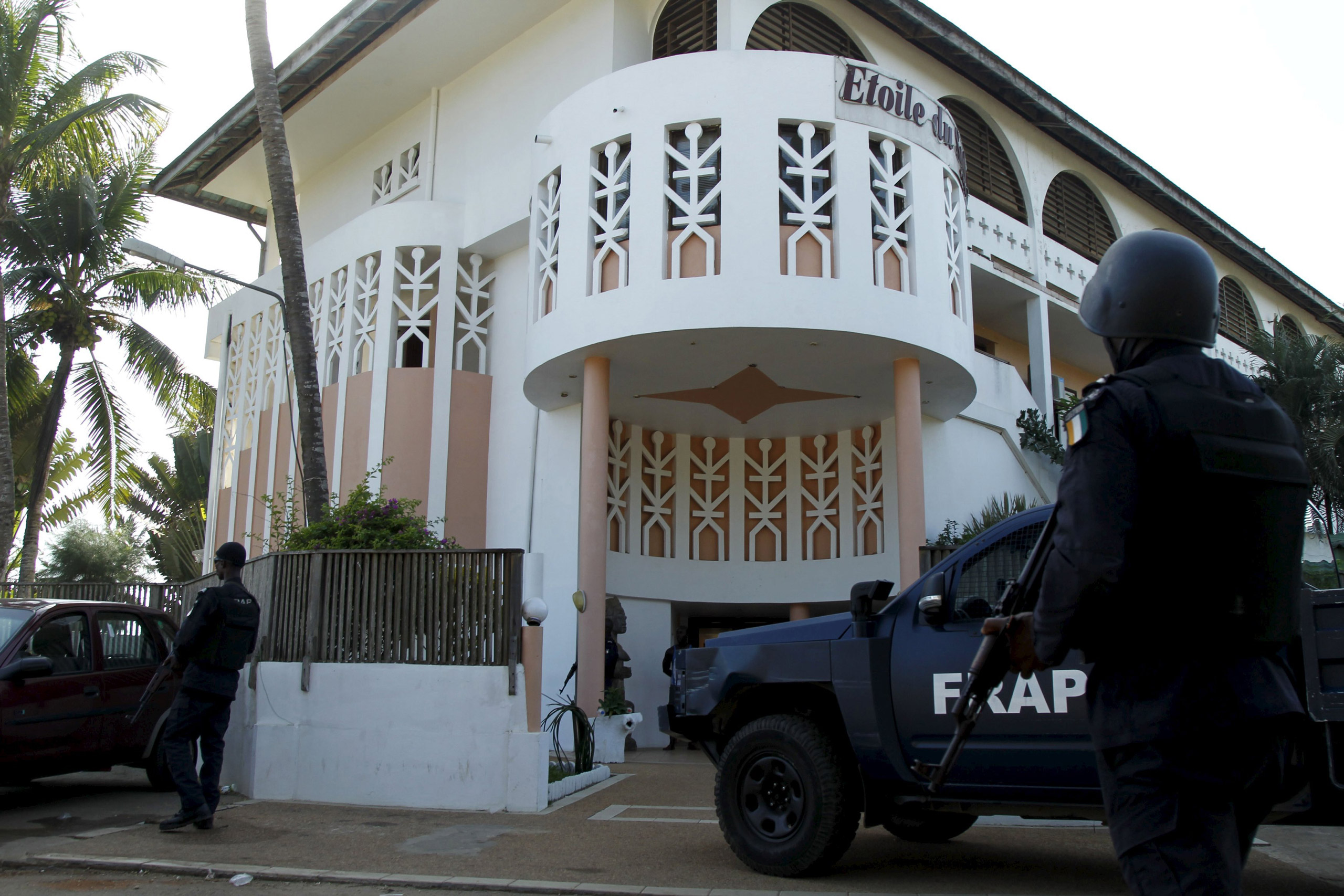 Soldiers stand guard in front of the Etoile du Sud hotel after the attacks in Grand-Bassam, Ivory Coast, on March 13, 2016.