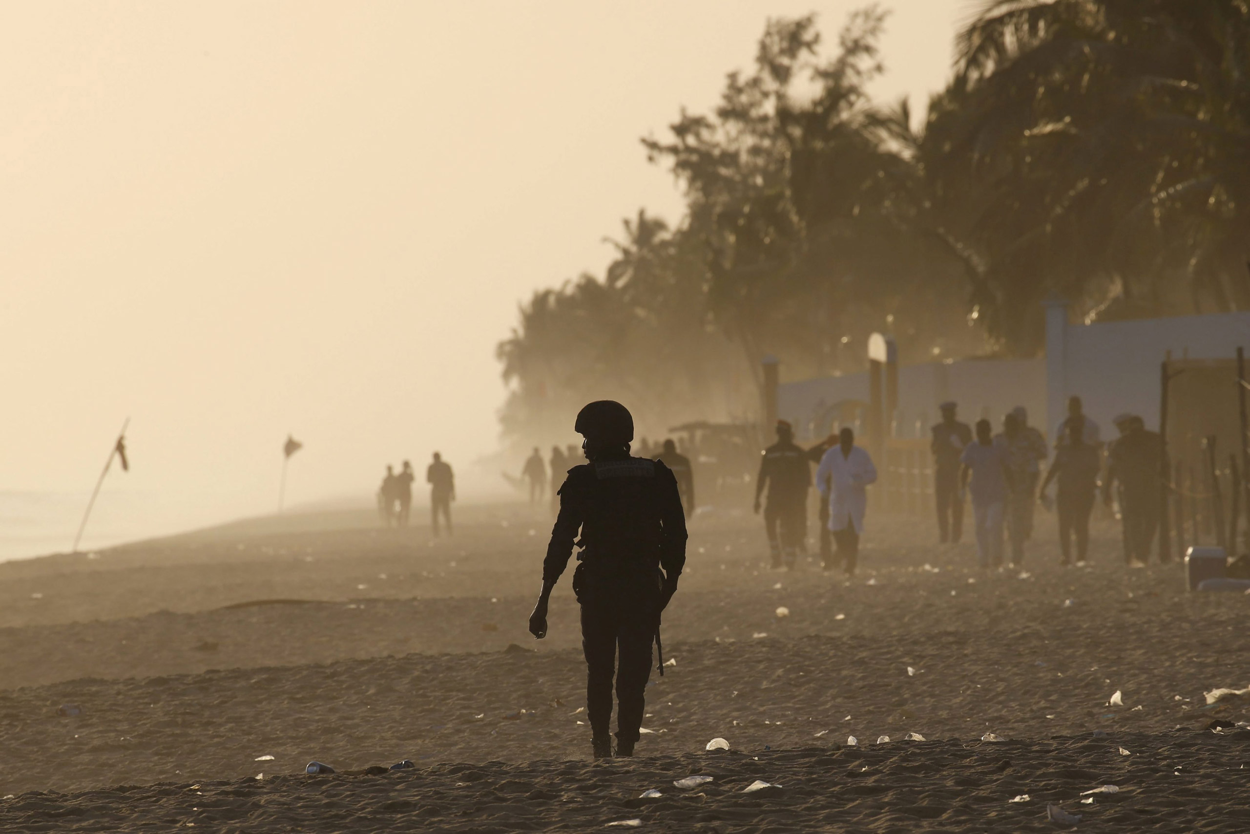 A security officer walks on the beach after an attack in Grand-Bassam, Ivory Coast, on March 13, 2016.