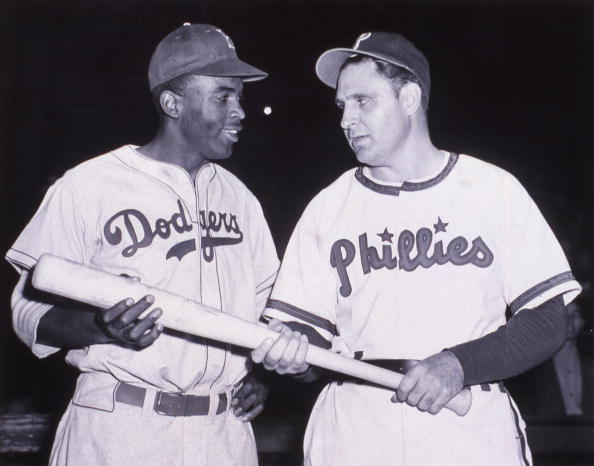 Jackie Robinson of the Brooklyn Dodgers, left, talks with nemesis Ben Chapman of the Philadelphia Phillies in the middle of the 1947 N.L. season.