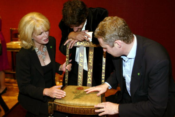 Actress Joanna Lumley (L), Miles Apthorp (C) and actor Rory Bremner (R) inspect the JK Rowling 'Harry Potter' chair at the Chairish the Child celebrity auction held at Christie's on September 4, 2002 in London, England.  Miles Apthorp made a winning bid for the chair.