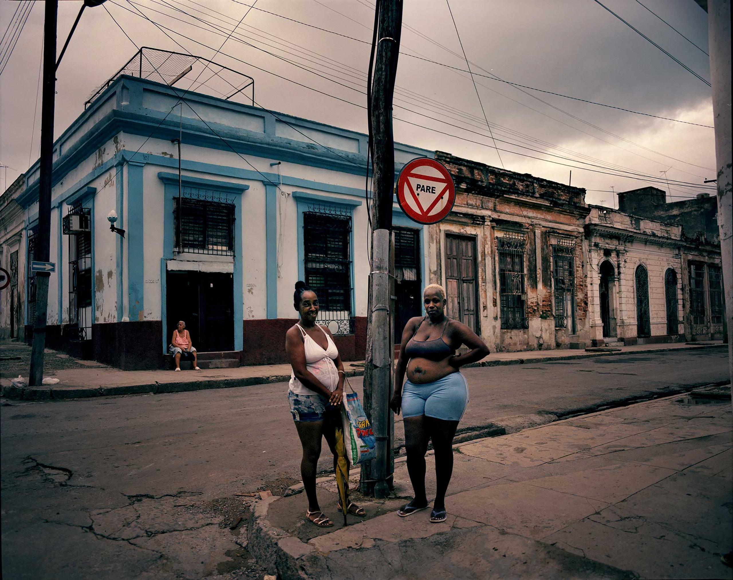Women chatting in Cienfuegos, 270 kilometers east of Havana, Cuba.