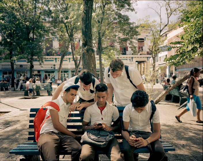 Young people gather at a Havana city park, where there is a Wi-Fi hotspot.