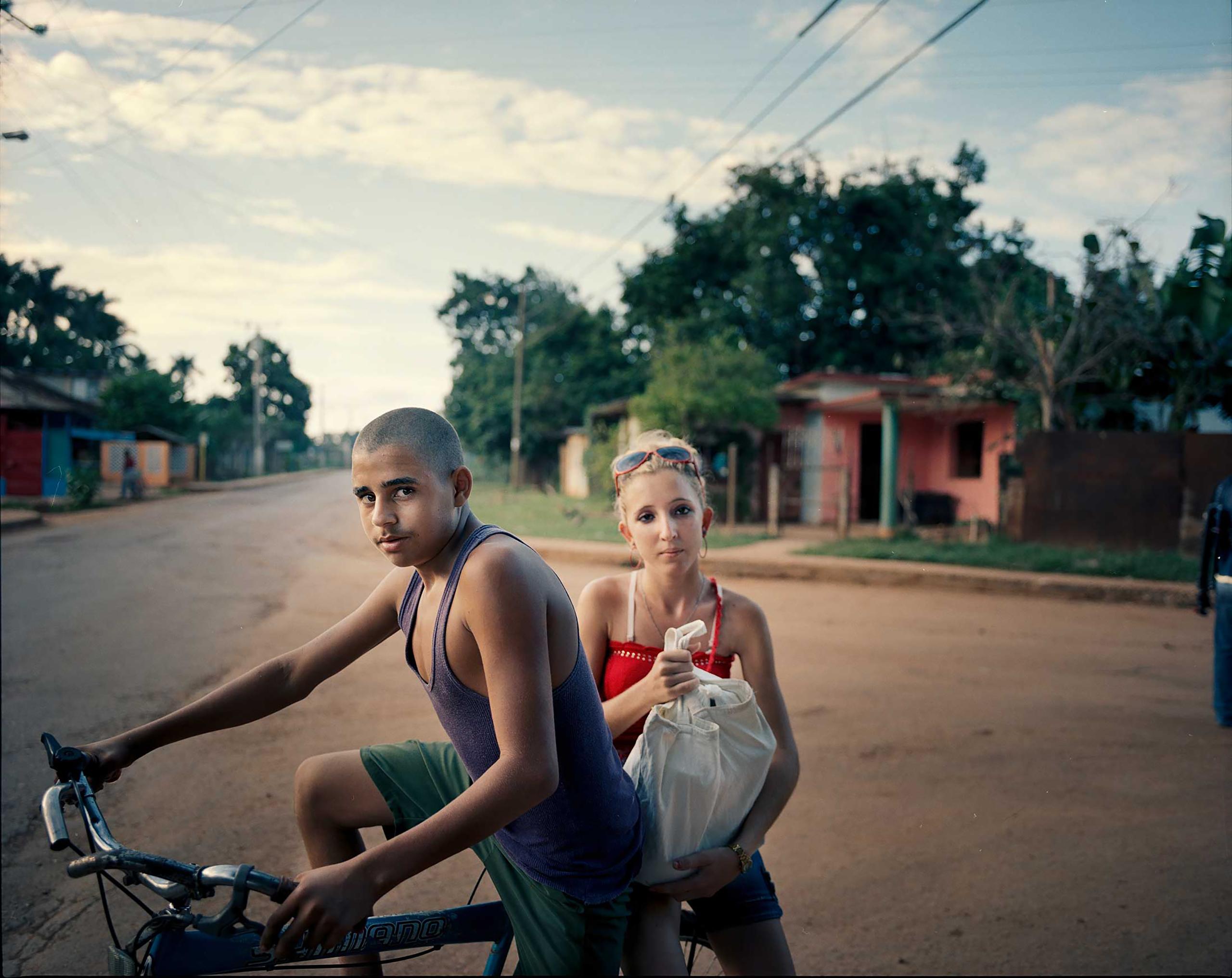A young  couple run errands on a bike in Artemisa province, south of Havana, Cuba.