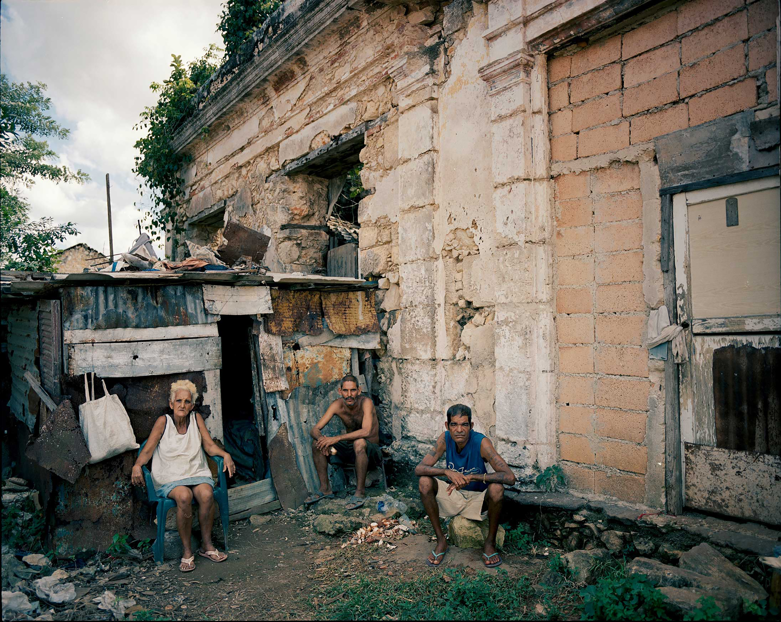 A family, fearing their roof might collapse, built a shack next to their former house near Havana.