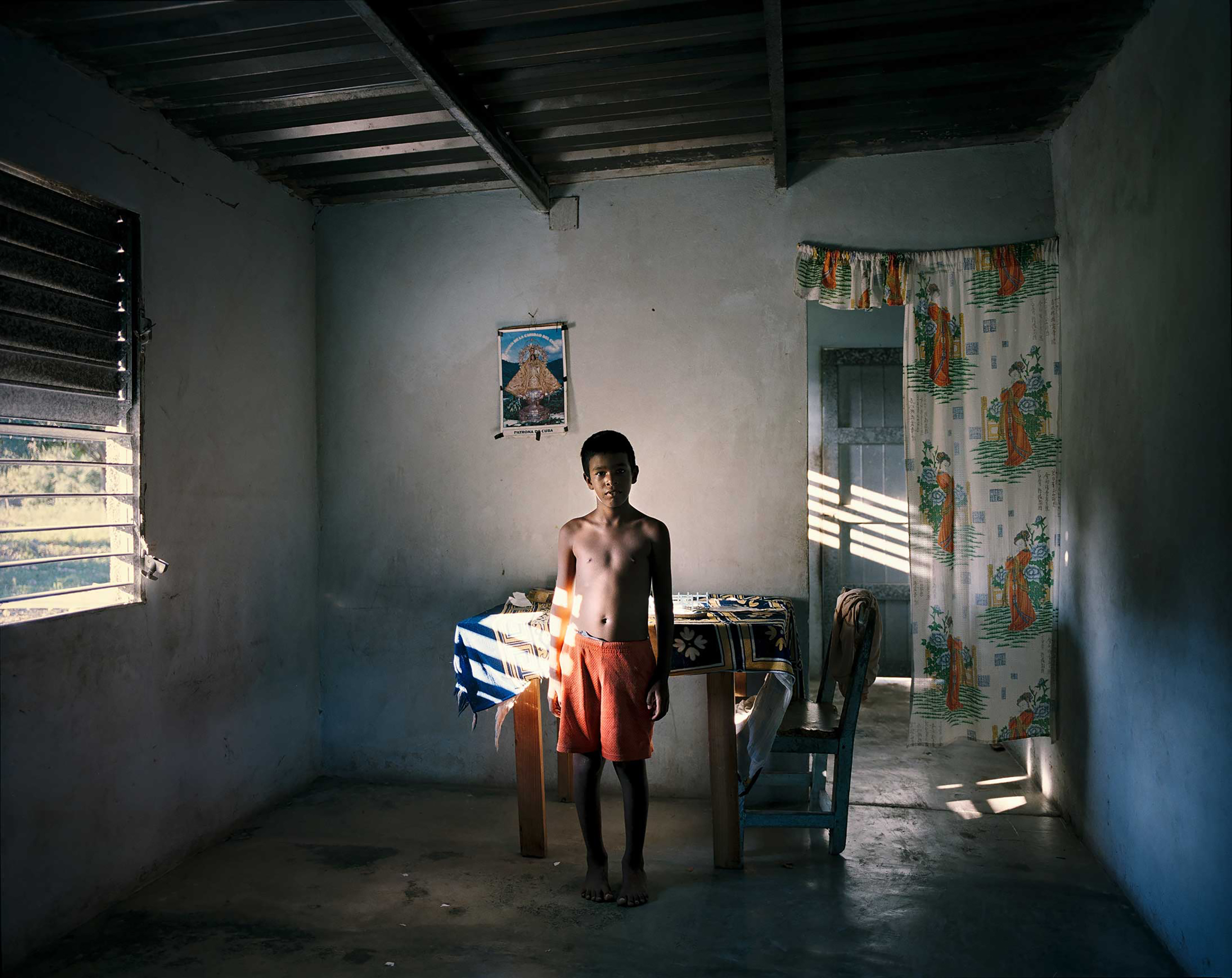 An 8-year-old boy in his house on the south coast of Cuba.