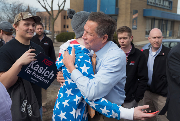 Republican presidential candidate Ohio Gov. John Kasich greets supporters following a rally at the Lansing Brewing Company on March 8, 2016 in Lansing, Michigan.