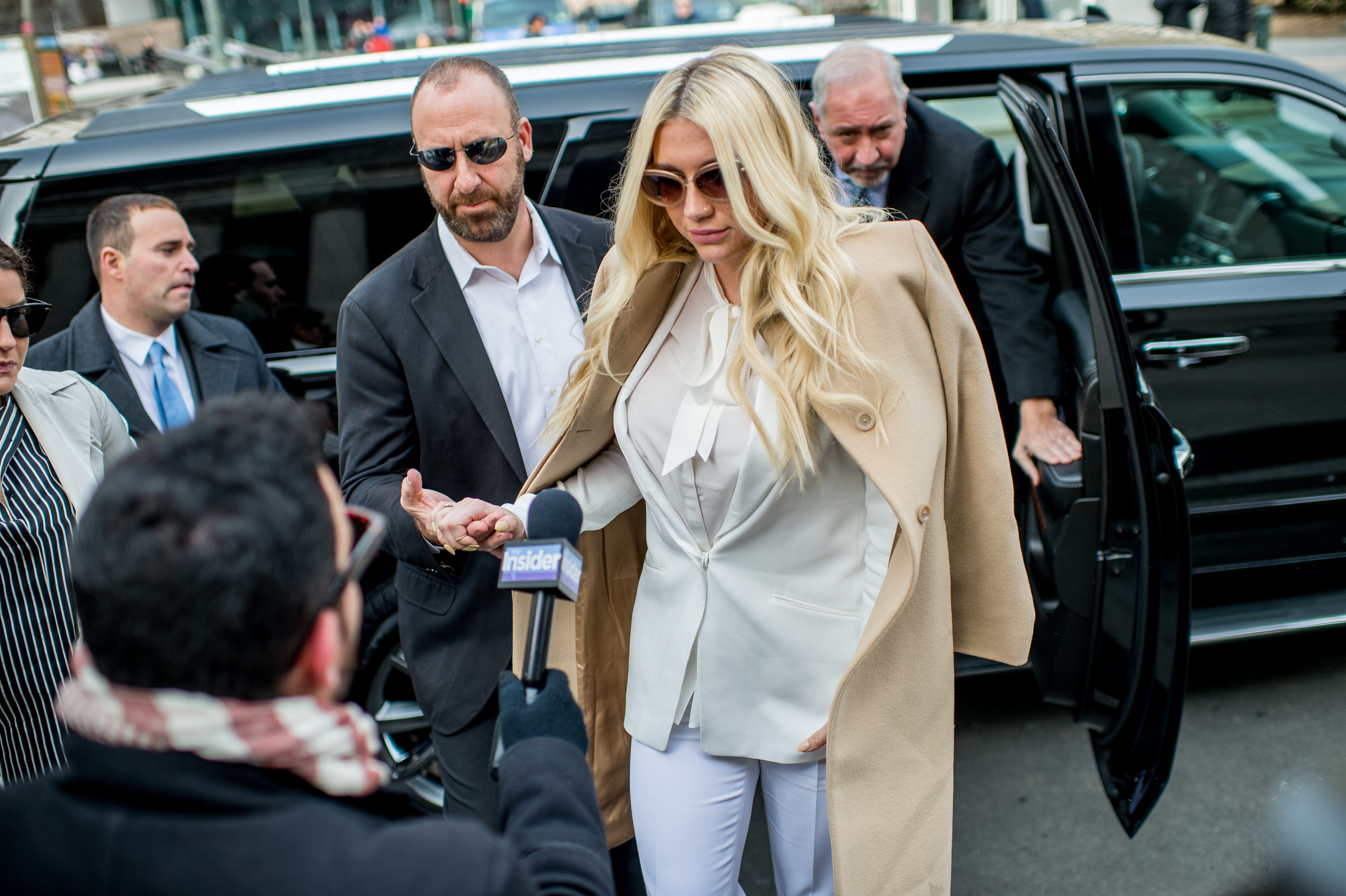 Kesha makes a court appearance as fans protest Sony Music Entertainment outside New York State Supreme Court on February 19, 2016 in New York City. Sony has refused to voluntarily release the pop star from her contract which requires her to make eight more albums with producer Dr. Luke, a man she claims sexually assaulted her.