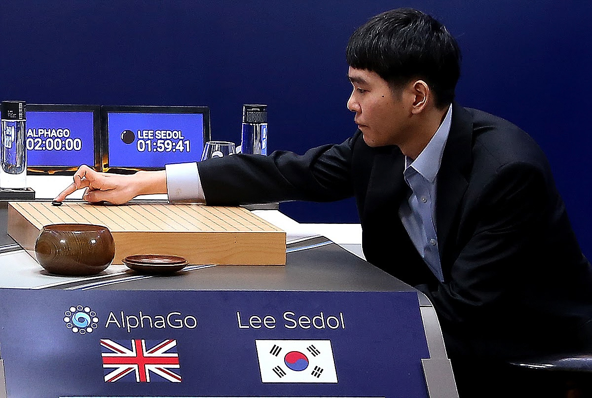 In this handout image provided by Google, South Korean professional Go player Lee Se-Dol (R) puts the first stone against Google's artificial intelligence program, AlphaGo, during the Google DeepMind Challenge Match on March 9, 2016 in Seoul, South Korea.