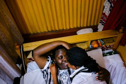 Cynthia is a lesbian activist and refugee from Burundi. She fled her country after authorities found out she was gay. They beat her and cut her with machetes. Here, she lays in bed with her Kenyan girlfriend in the apartment the two shared in Nairobi, Kenya (though they have since moved). Cynthia is due to be resettled in the United States any day now, though that has been the case for months.