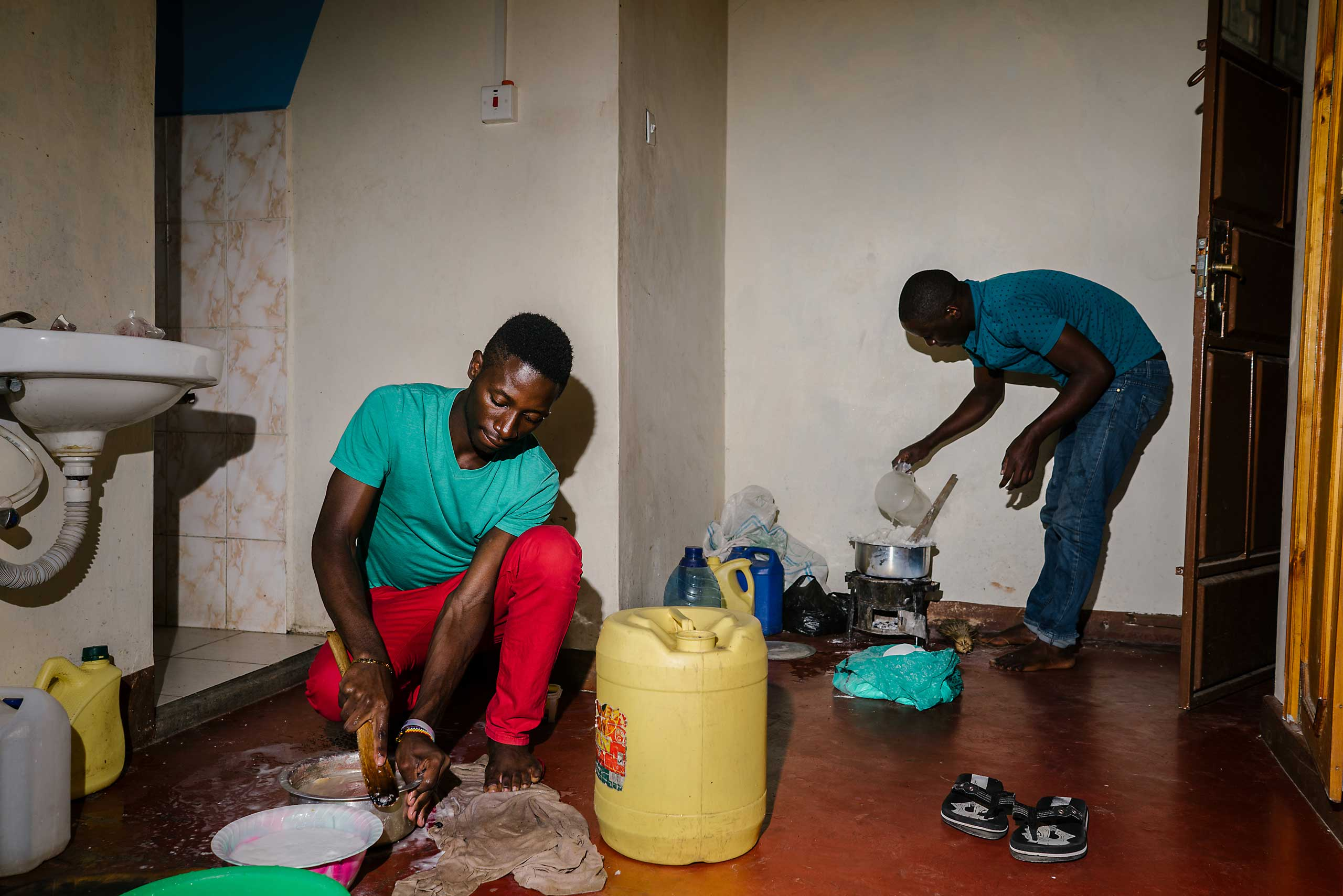 S. and J. prepare food for themselves and others in the house they lived in outside of Nairobi.