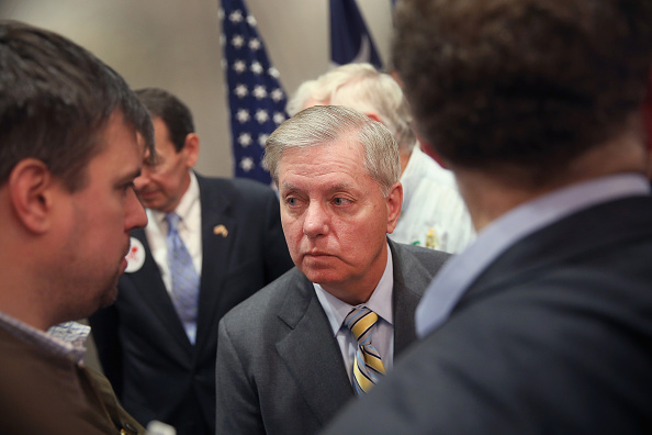 Former Republican presidential candidate and South Carolina Sen. Lindsey Graham speaks to reporters after announcing his endorsement of Jeb Bush for president on January 15, 2016 in North Charleston, South Carolina.