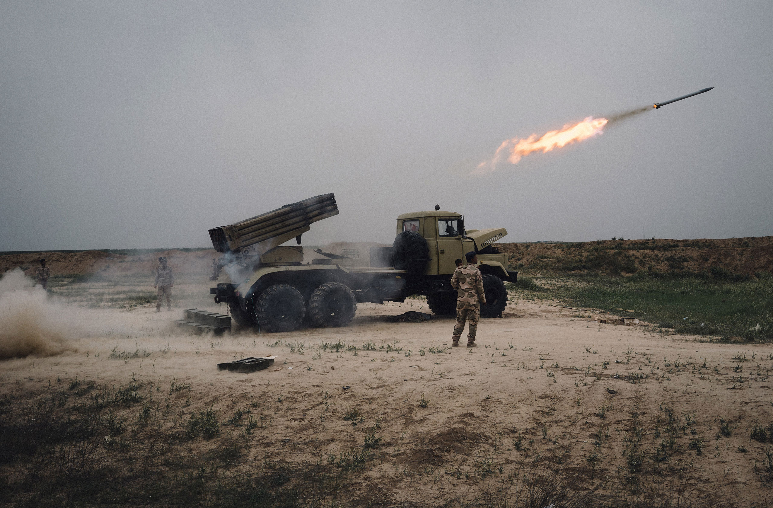 A rocket is fired outside Makhmour, about 75 km (47 miles) east of Mosul, Iraq, March 25, 2016.