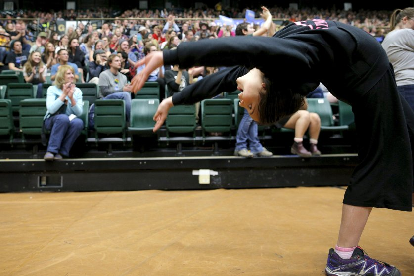 A girl does a backflip during a campaign rally for Democratic presidential candidate, Vermont Sen. Bernie Sanders in Fort Collins, Colo. on Feb. 28.