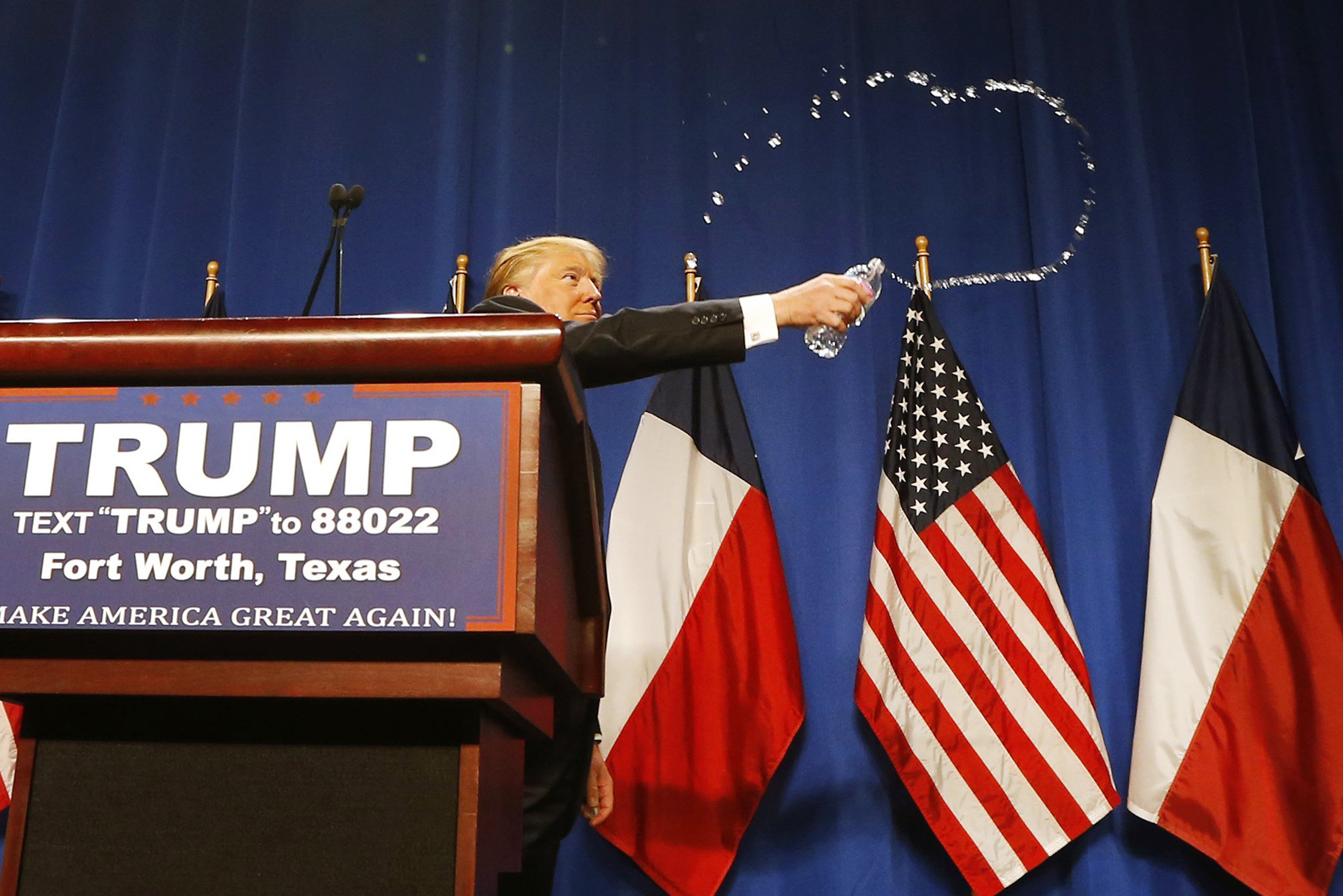 Republican presidential candidate Donald Trump slings water from a bottle during a rally in Fort Worth, Texas on Feb. 26.
