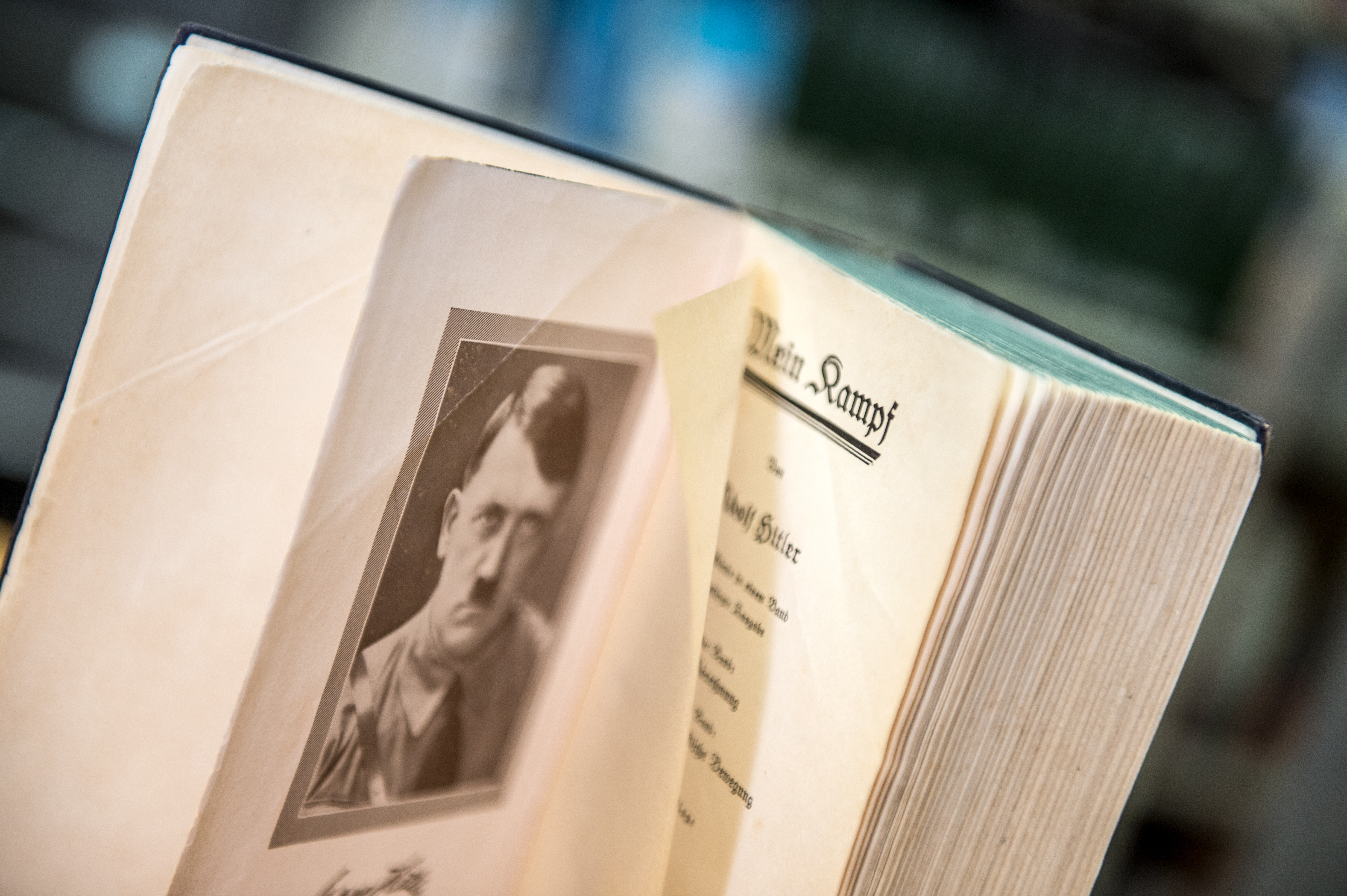 An opened page of the original edition of Hitler's inflammatory pamphlet  'Mein Kampf' shows a portrait of national socialist dictator Adolf Hitler, in a bookshop in Frankfurt, Germany on Jan.7, 2016.