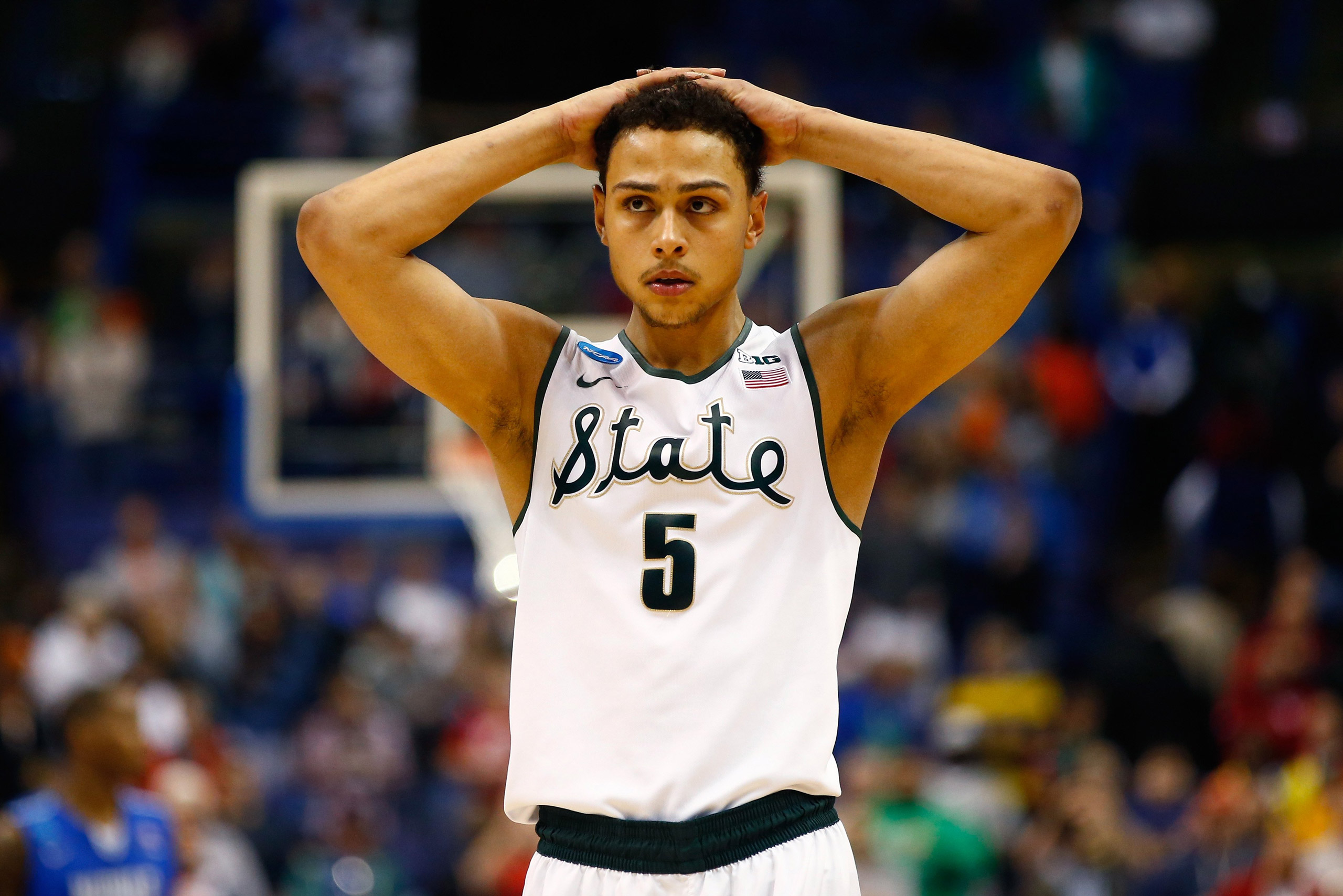 Bryn Forbes #5 of the Michigan State Spartans reacts late in the game against the Middle Tennessee Blue Raiders during the first round of the 2016 NCAA Men's Basketball Tournament at Scottrade Center in St Louis, Missouri, on Mar. 18, 2016.