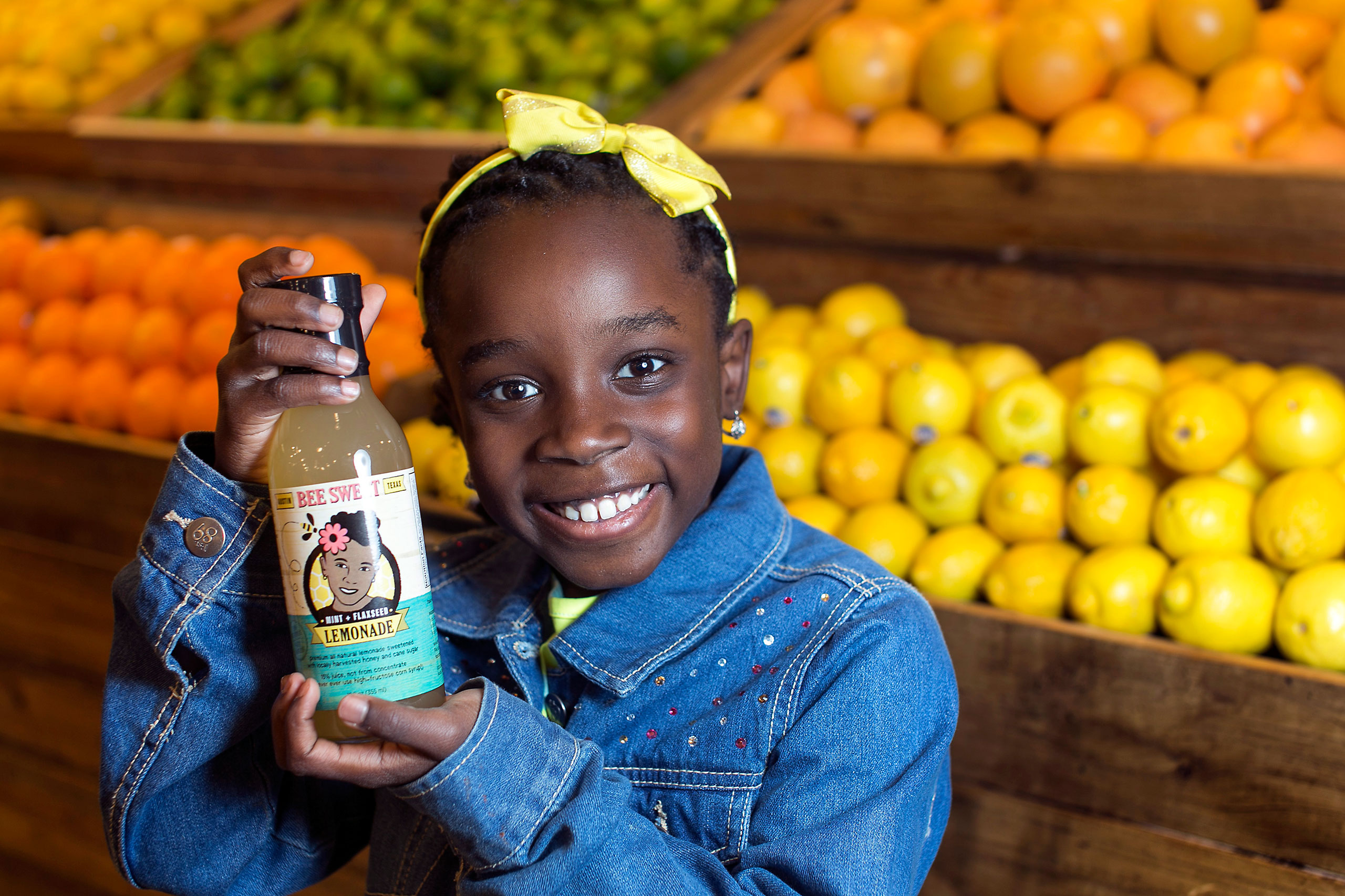 Mikaila Ulmer holds a bottle of BeeSweet Lemonade.