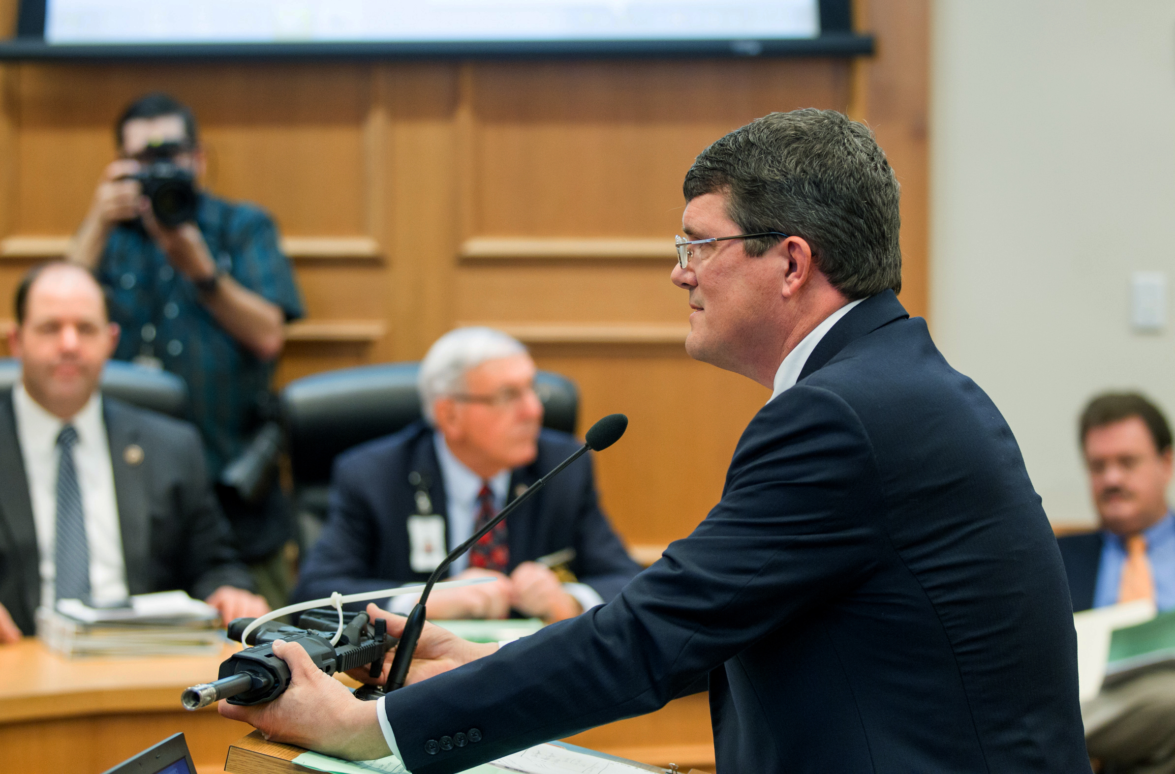 State Rep. Mike Stewart, D-Nashville, shows a gun he bought without a background check to the House Civil Justice subcommittee in Nashville, March 23, 2016.