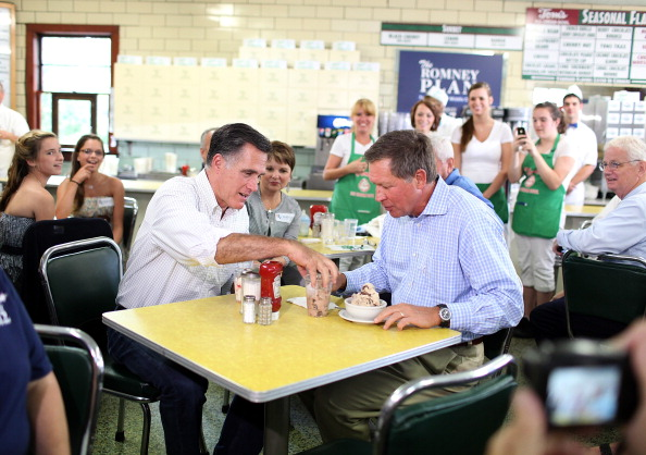 Republican presidential candidate and former Massachusetts Governor Mitt Romney (L) eats ice cream with Ohio Governor John Kasich during a campaign rally at Tom's Ice Cream Bowl on August 14, 2012 in Zanesville, Ohio.