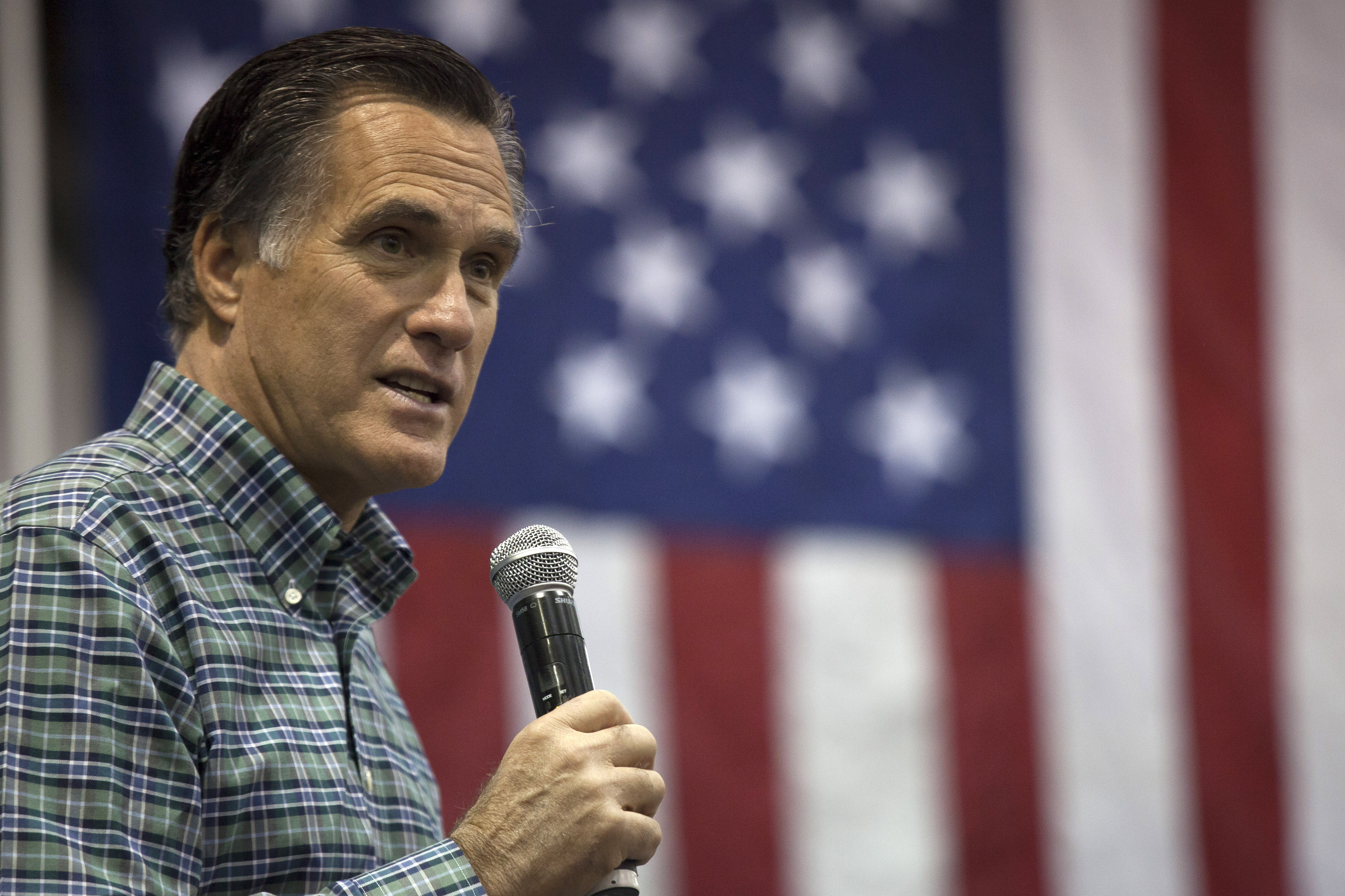Former Mass. Gov. Mitt Romney addresses the crowd during a rally for Republican Senate candidate Dan Sullivan  on Nov. 3, 2014 in Anchorage, Alaska.