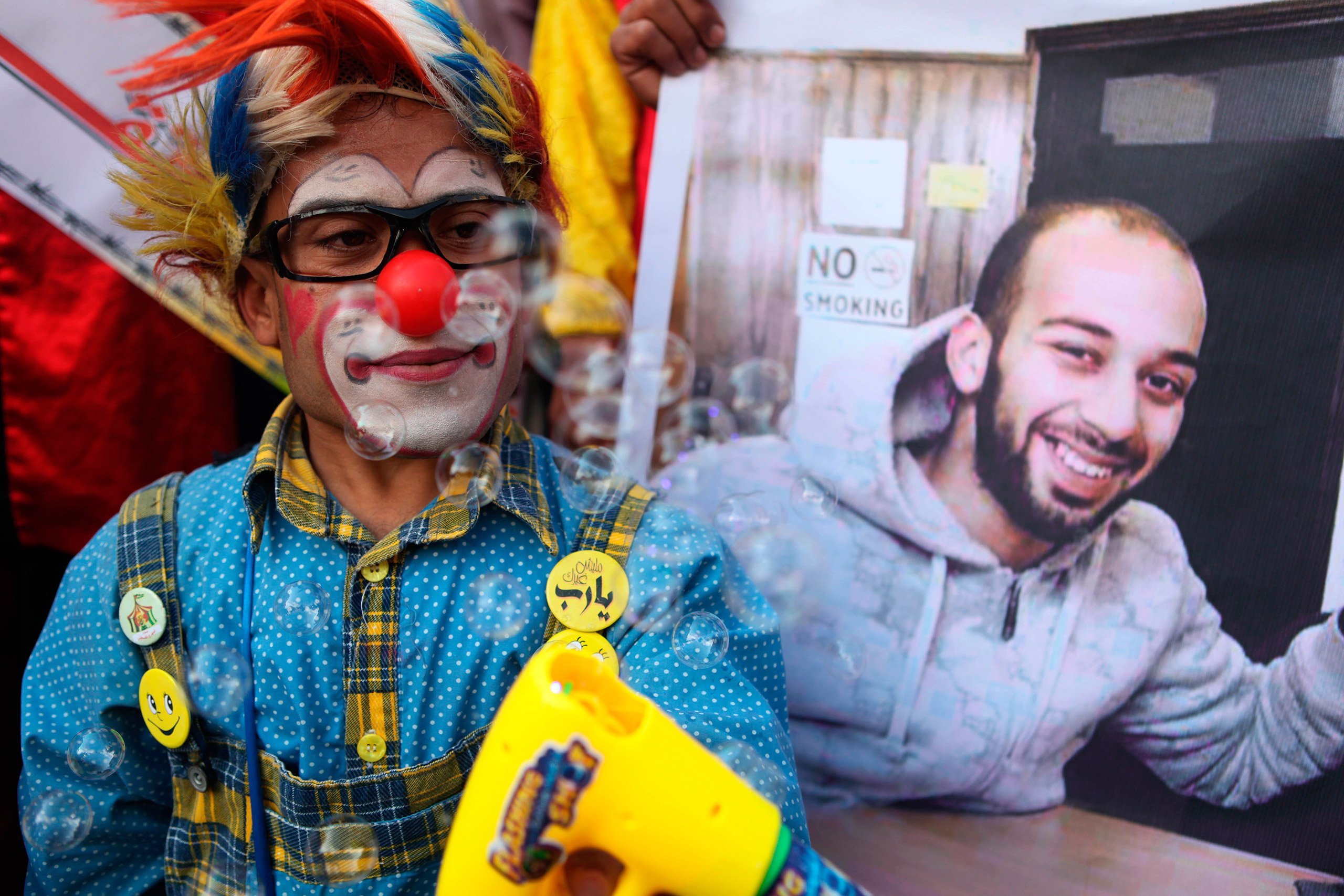 Palestinians clowns during a show of solidarity for their colleague, Mohammed Abu Sakha, who was jailed by Israel in December, in front of the Red Cross office in Gaza City, Feb. 8, 2016.